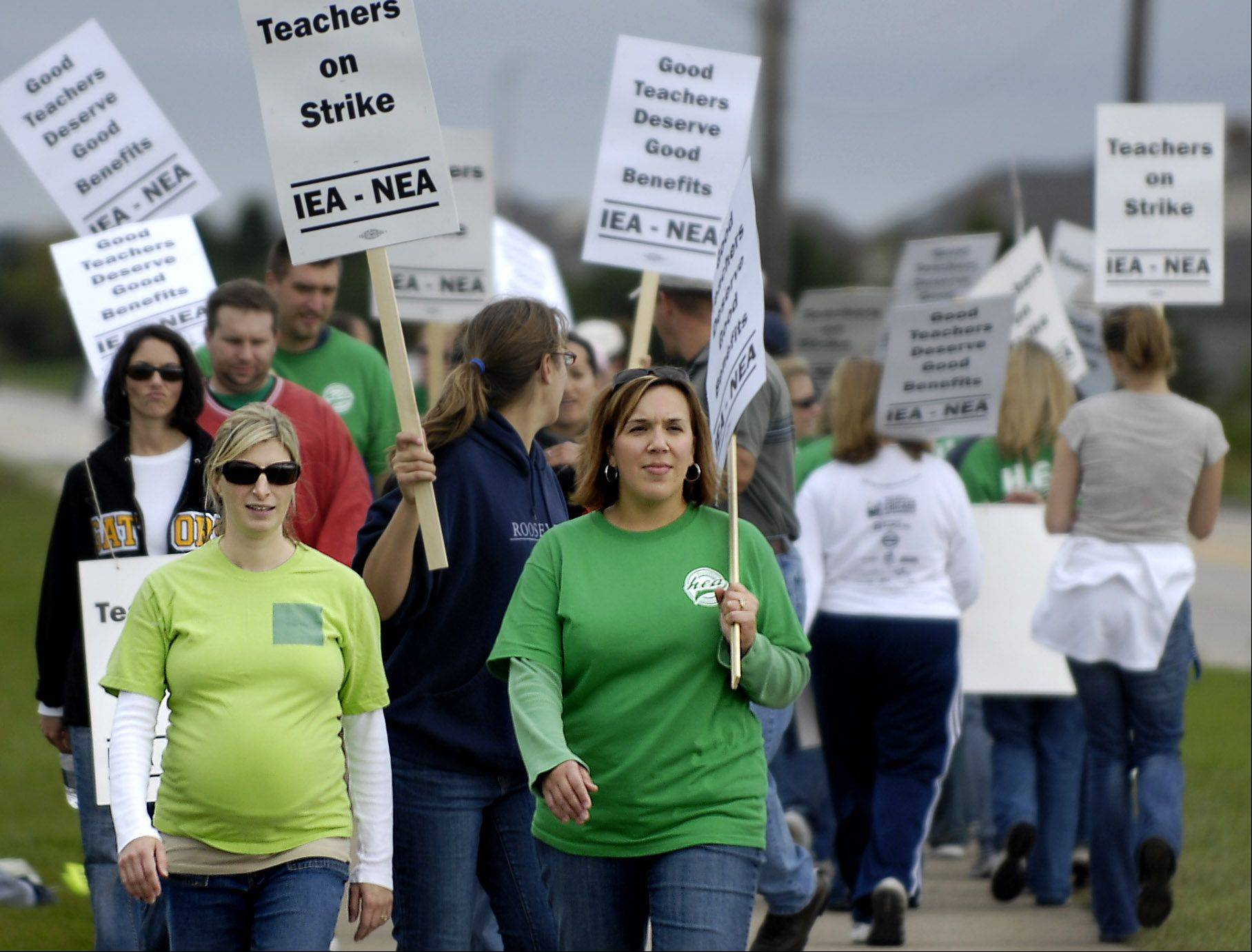 Suburban teachers' right to strike was not taken away in recent education reforms, though the law will make it tougher for Chicago teachers to strike. Above, teachers in Huntley went on strike in 2008.