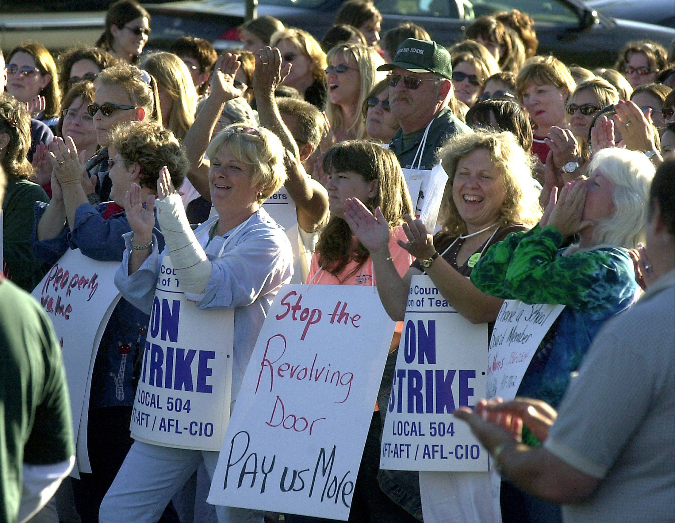 Suburban teachers' right to strike was not taken away in recent education reforms, though the law will make it tougher for Chicago teachers to strike. Above, a strike rally in Gurnee in 2003.