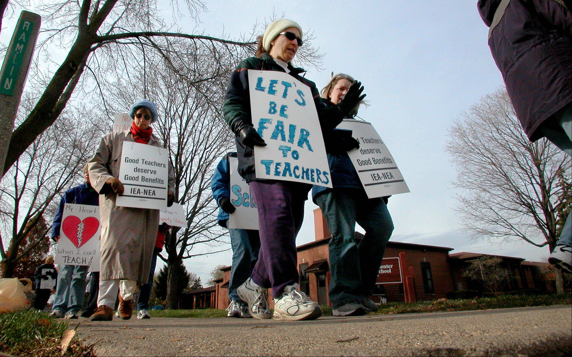 Suburban teachers' right to strike was not taken away in recent education reforms, though the law will make it tougher for Chicago teachers to strike. Above, teachers walk a picket line in Park Ridge in 2003.