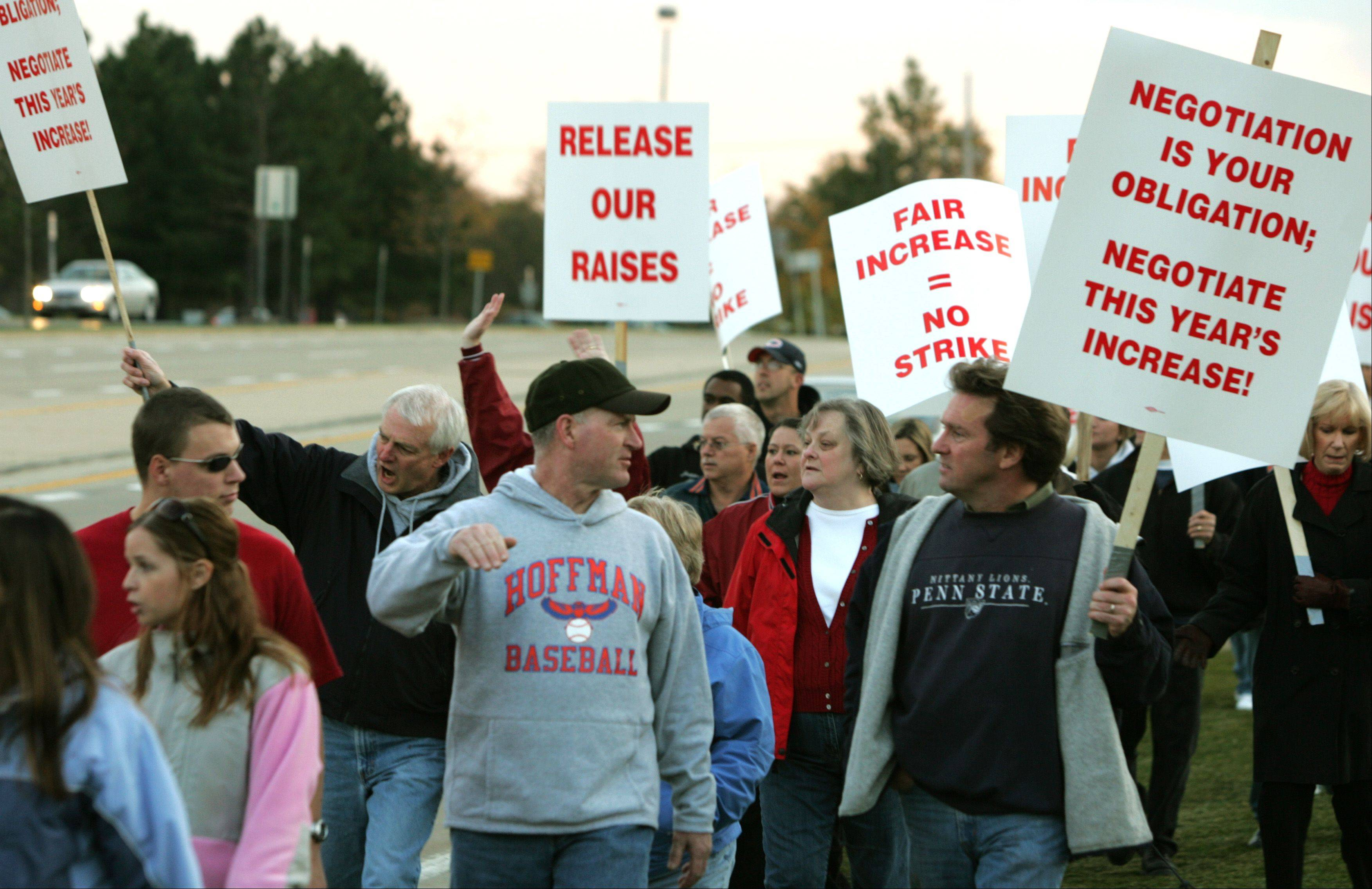 Daniel White/dwhite@dailyherald.comSuburban teachers' right to strike was not taken away in recent education reforms, though the law will make it tougher for Chicago teachers to strike. Above, teachers in Palatine picket in 2007.