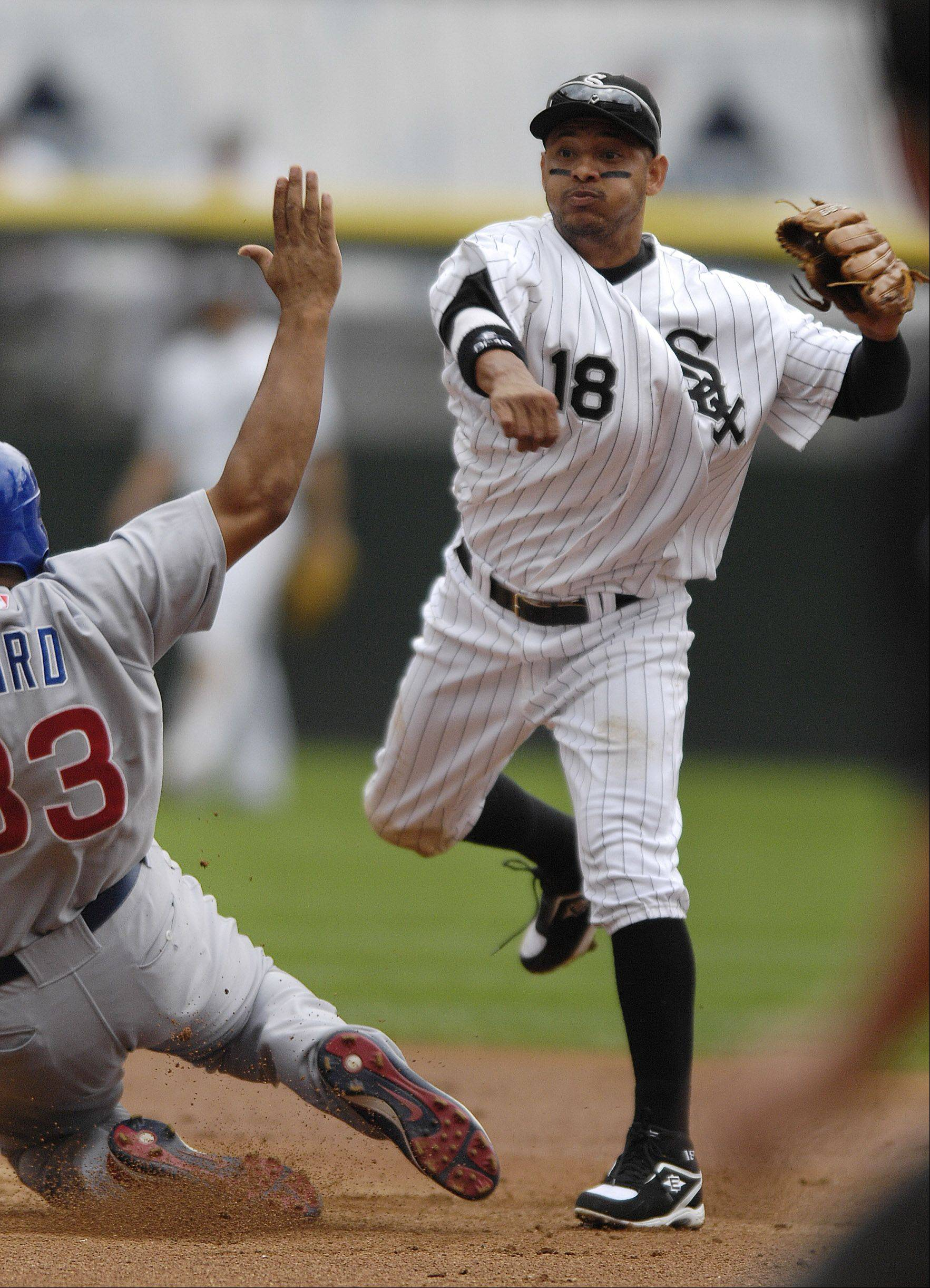 White Sox shortstop Orlando Cabrera throws as Cub Daryle Ward breaks up the double play in the second inning of the White Sox 10-3 win Friday at U.S. Cellular Field.