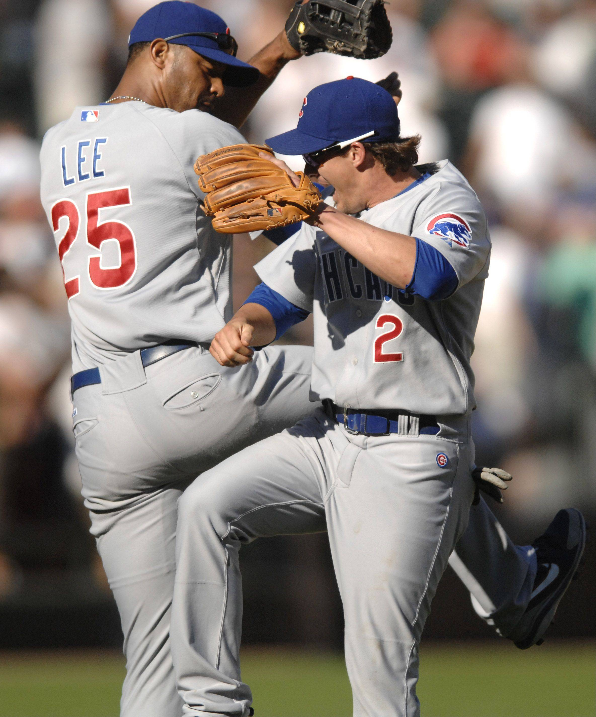 Chicago Cubs' Derrek Lee and Ryan Theriot celebrate after their win over the Sox in the Crosstown Classic at U.S. Cellular Field on Friday, June 26.