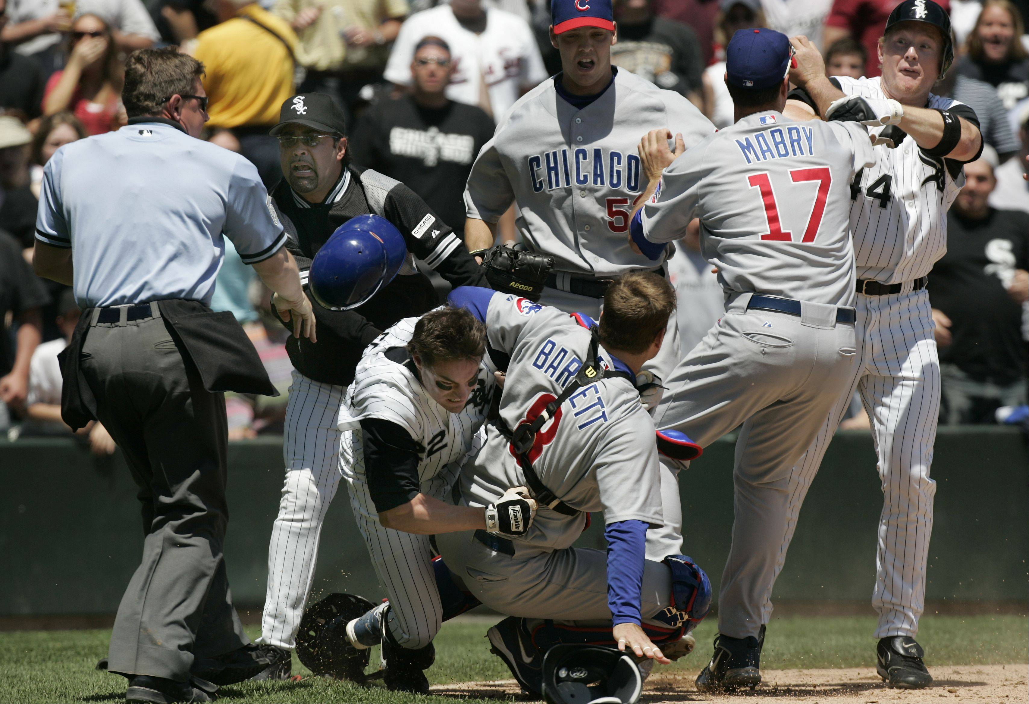 Sox Scott Podsednik tackles Michael Barrett as Ozzie Guillen rushes out and Cubs John Mabry and Sox Brian Anderson go at it Home plat ump Greg Gibson during Game Two at U.S. Cellular Field in Chicago on May 20, 2006.