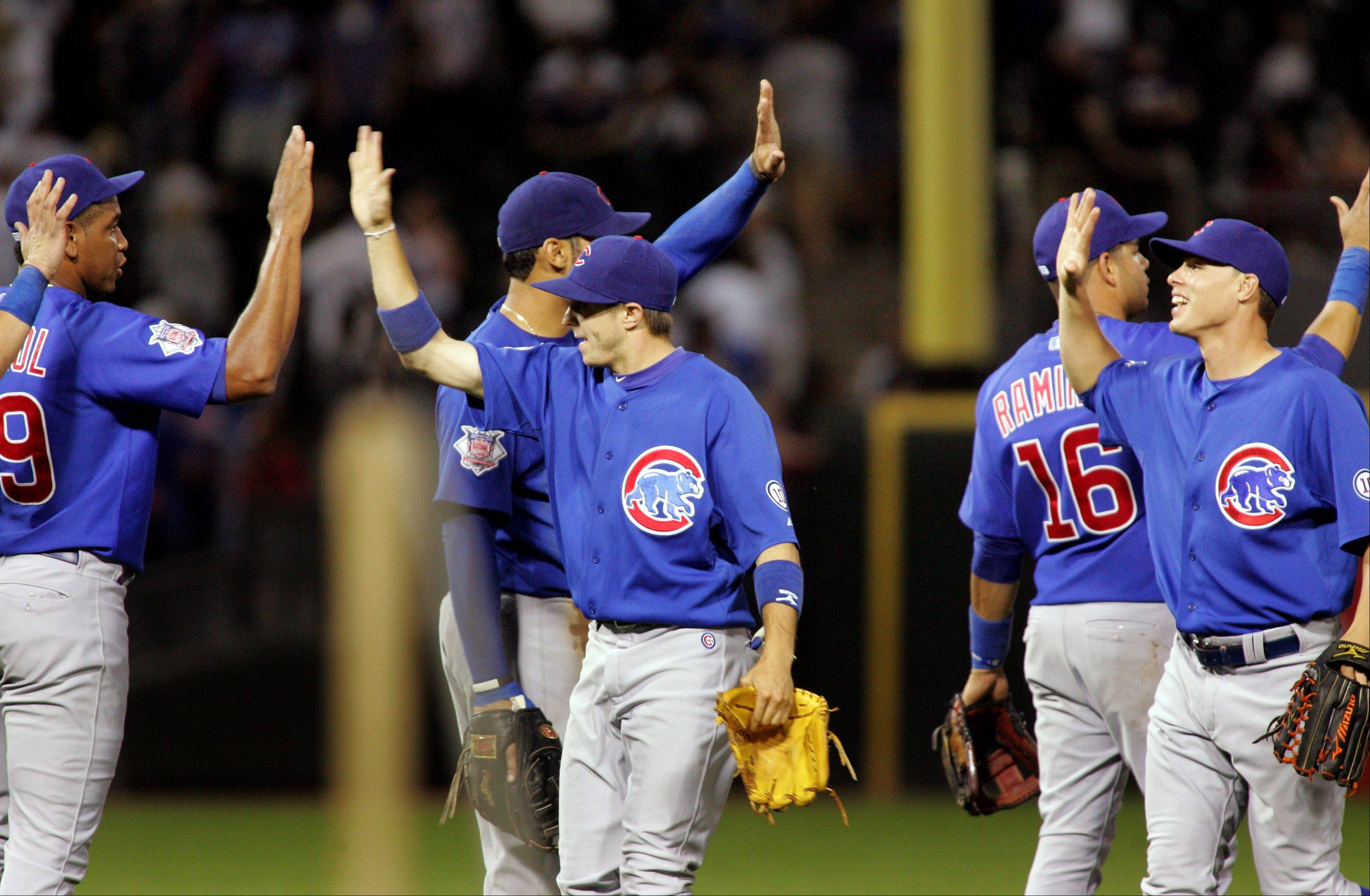 The Chicago Cubs celebrate their win over the Chicago White Sox.