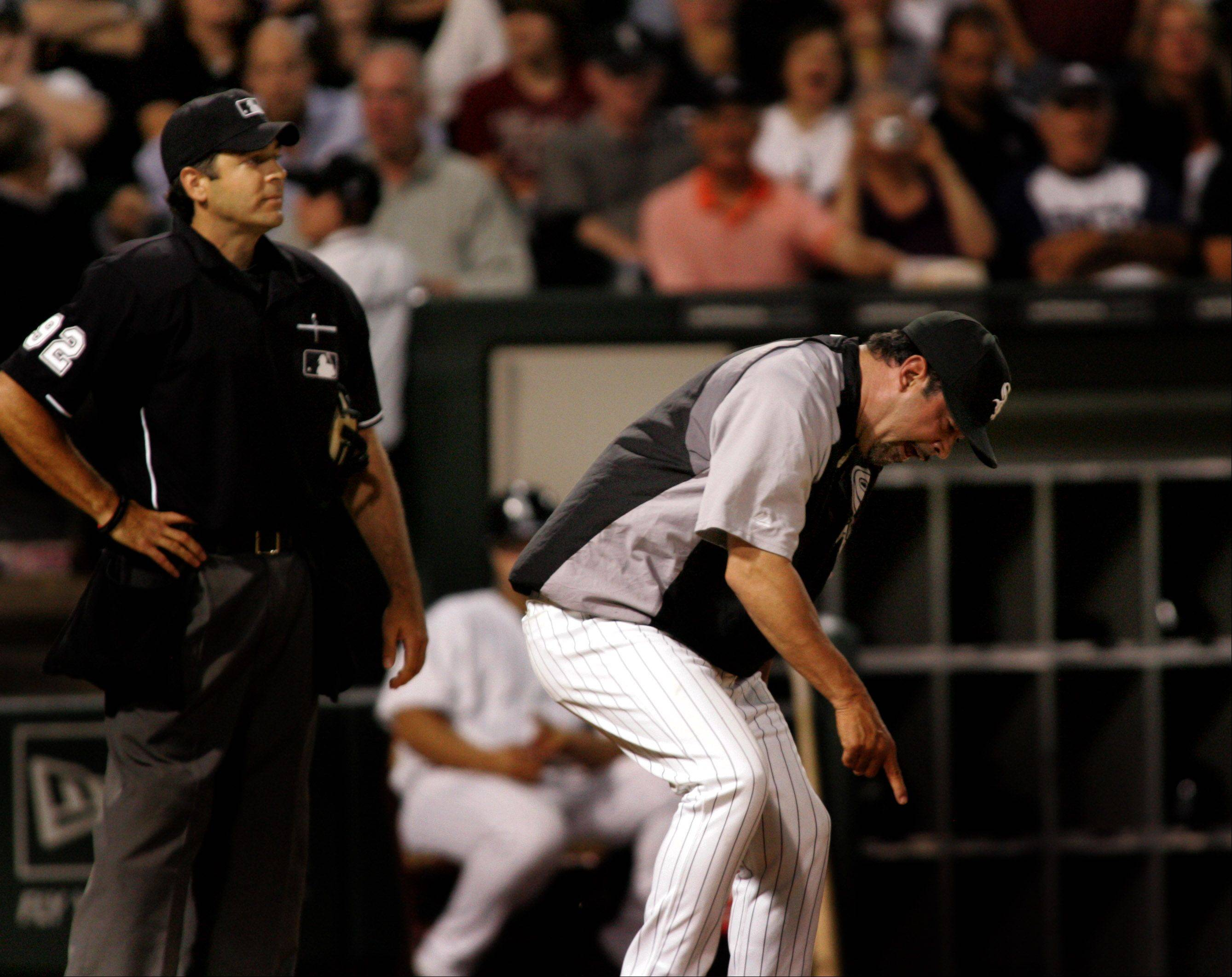 Ozzie Guillen, manager of the Chicago White Sox questions a call in the 6th inning and gets thrown out by home plate ump James Hoye during game one of the three game series