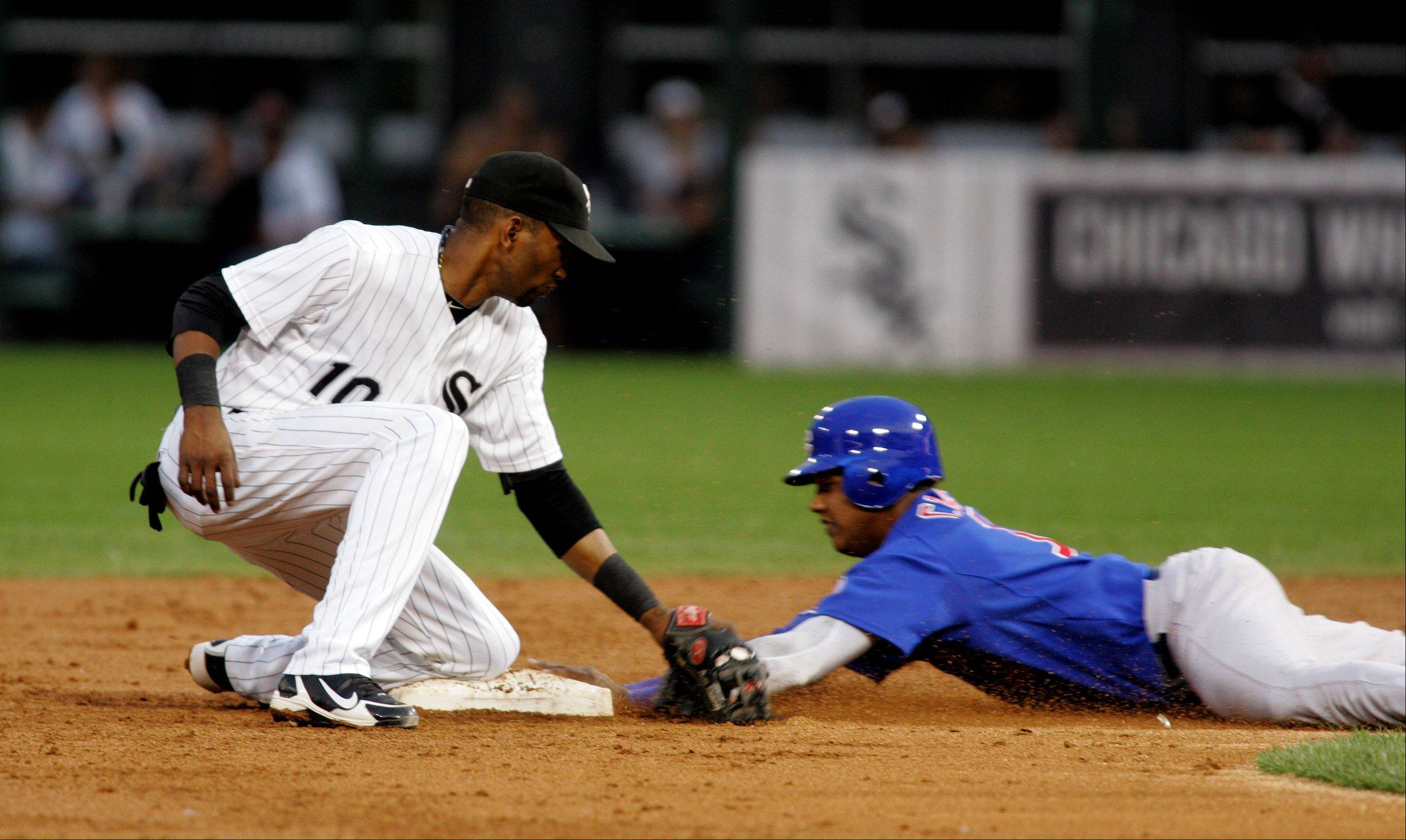 Alexei Ramirez of the Chicago White Sox reaches out for the tag at second, but Starlin Castro of the Chicago Cubs is safe.