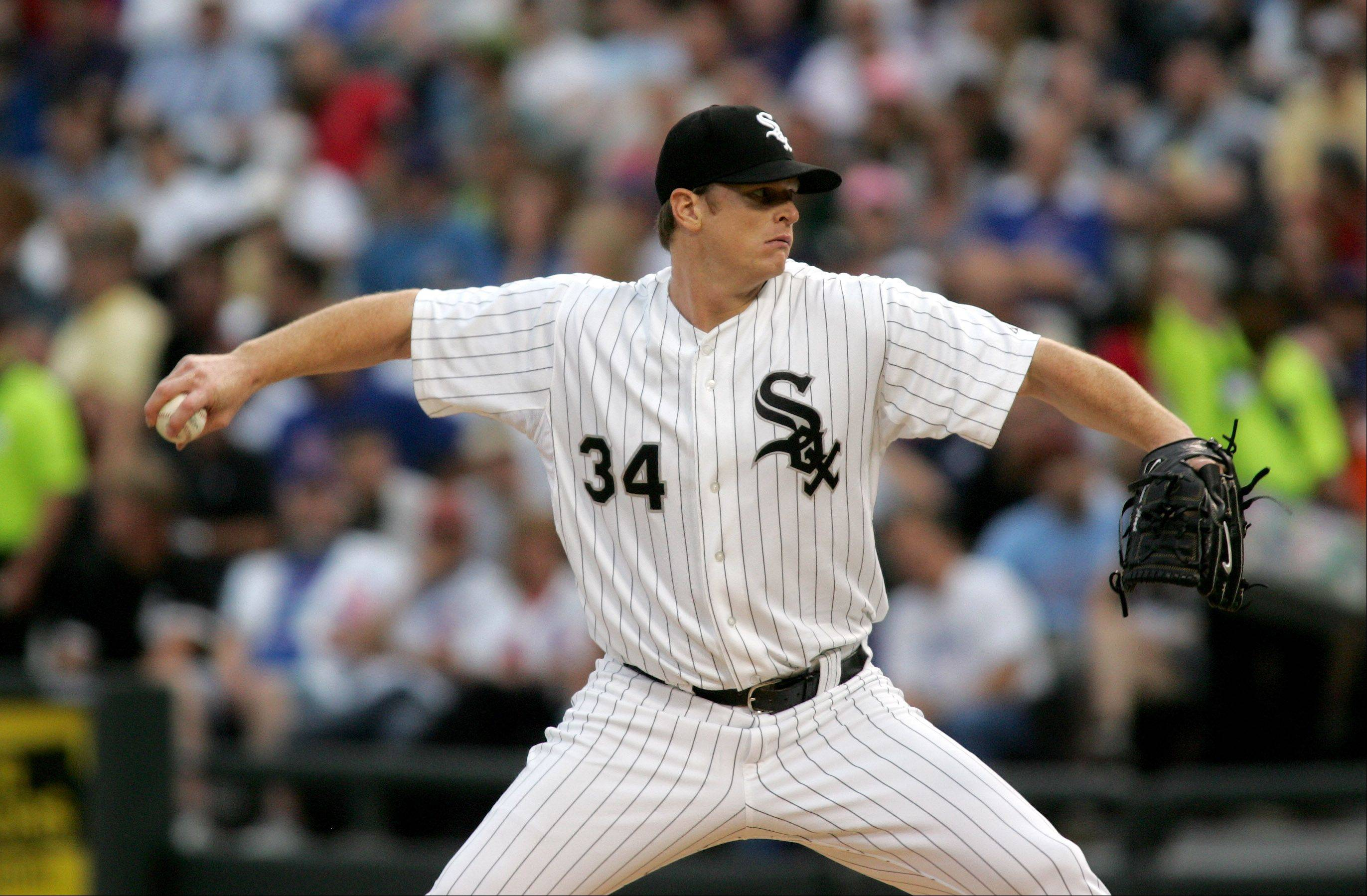Gavin Floyd of the Chicago White Sox pitches against the Chicago Cubs.