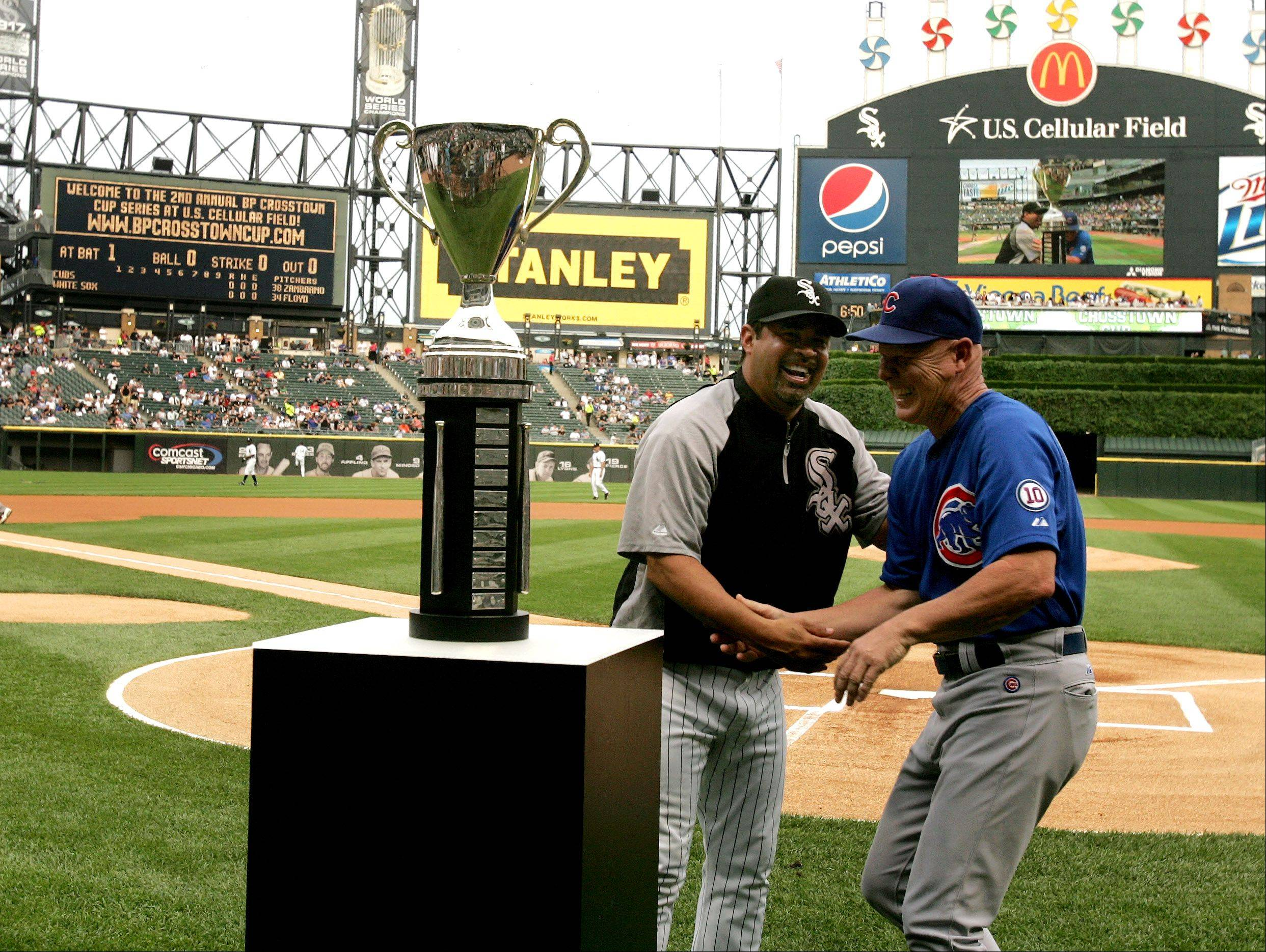 Managers Mike Quade and Ozzie Guillen of the Chicago Cubs and the Chicago White Sox before the start of the game Monday night.