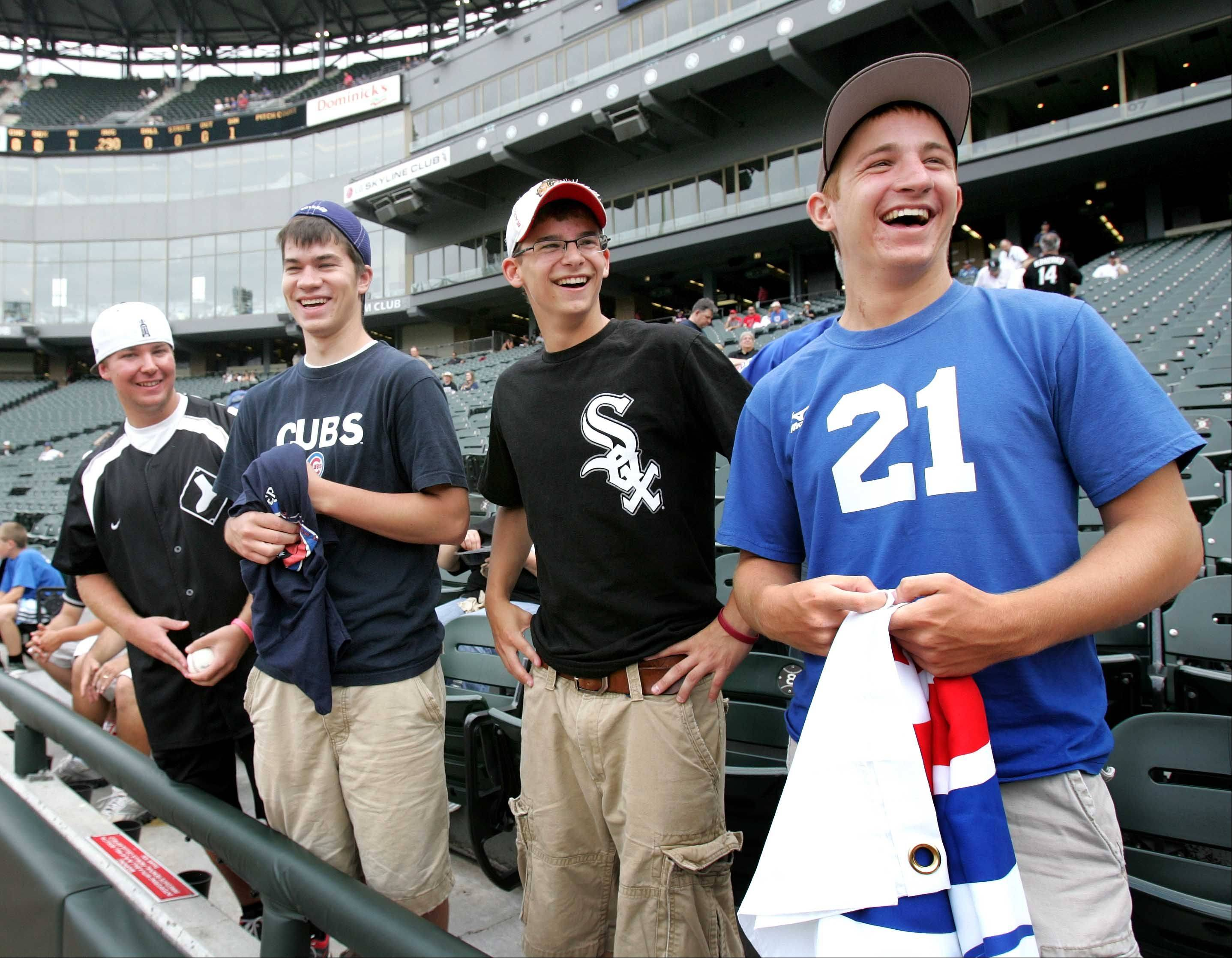 Friends Joe Caprio, from left, Chris Jelinek, Mitch Simpson and Nolan Hucek, all age 17 from Joliet, wait for the start of the Cubs and White Sox game Monday night.