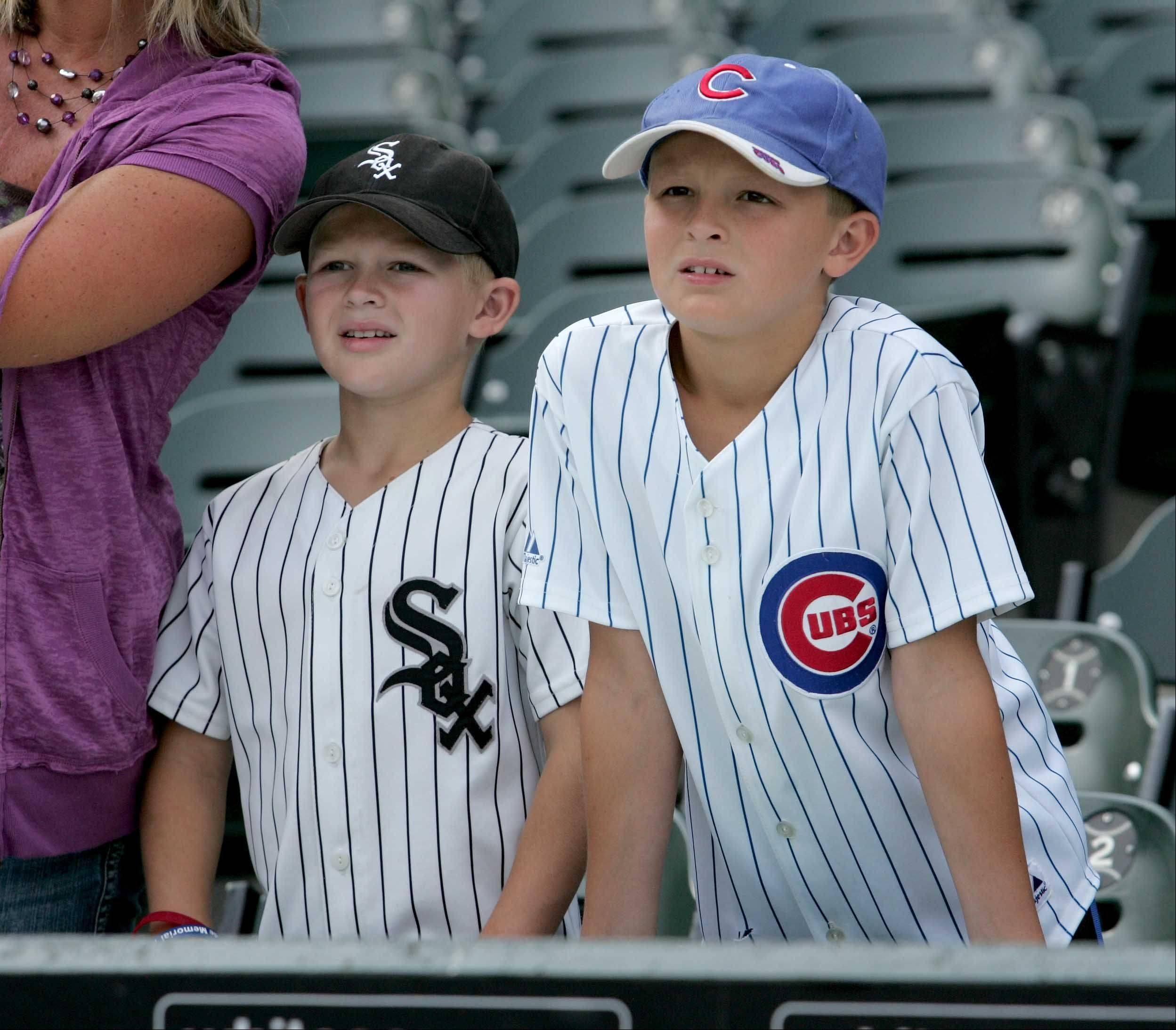 Brothers Jared Slivka, 8, left and Jacob Slivka, 10, right of Newark, wait for the start of the Cubs and White Sox Crosstown Classic Monday.