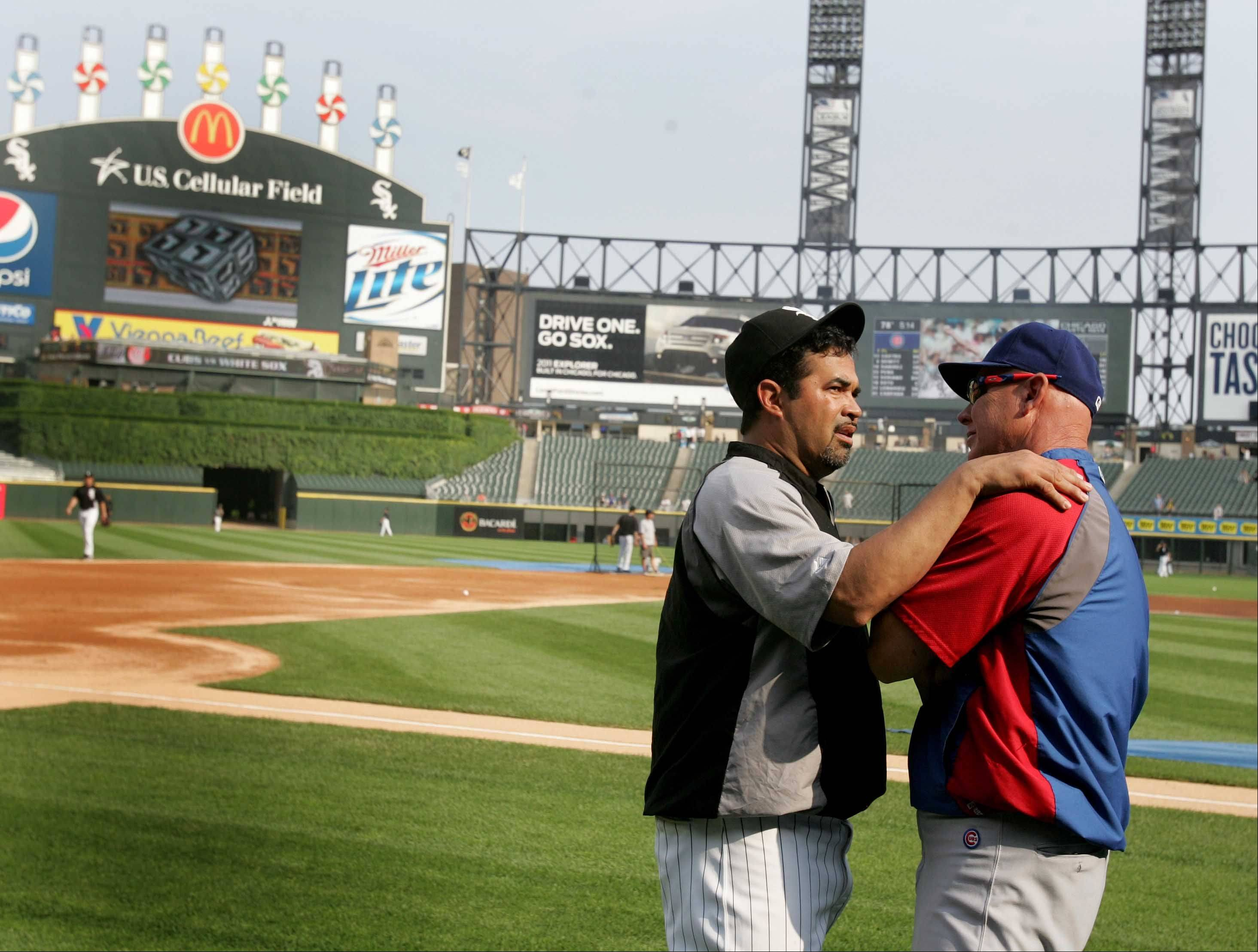 Chicago Cubs manger Mike Quade, right and Chicago White Sox manager Ozzie Guillen chat on the field before the Crosstown Classic Monday at U.S. Cellular Field.
