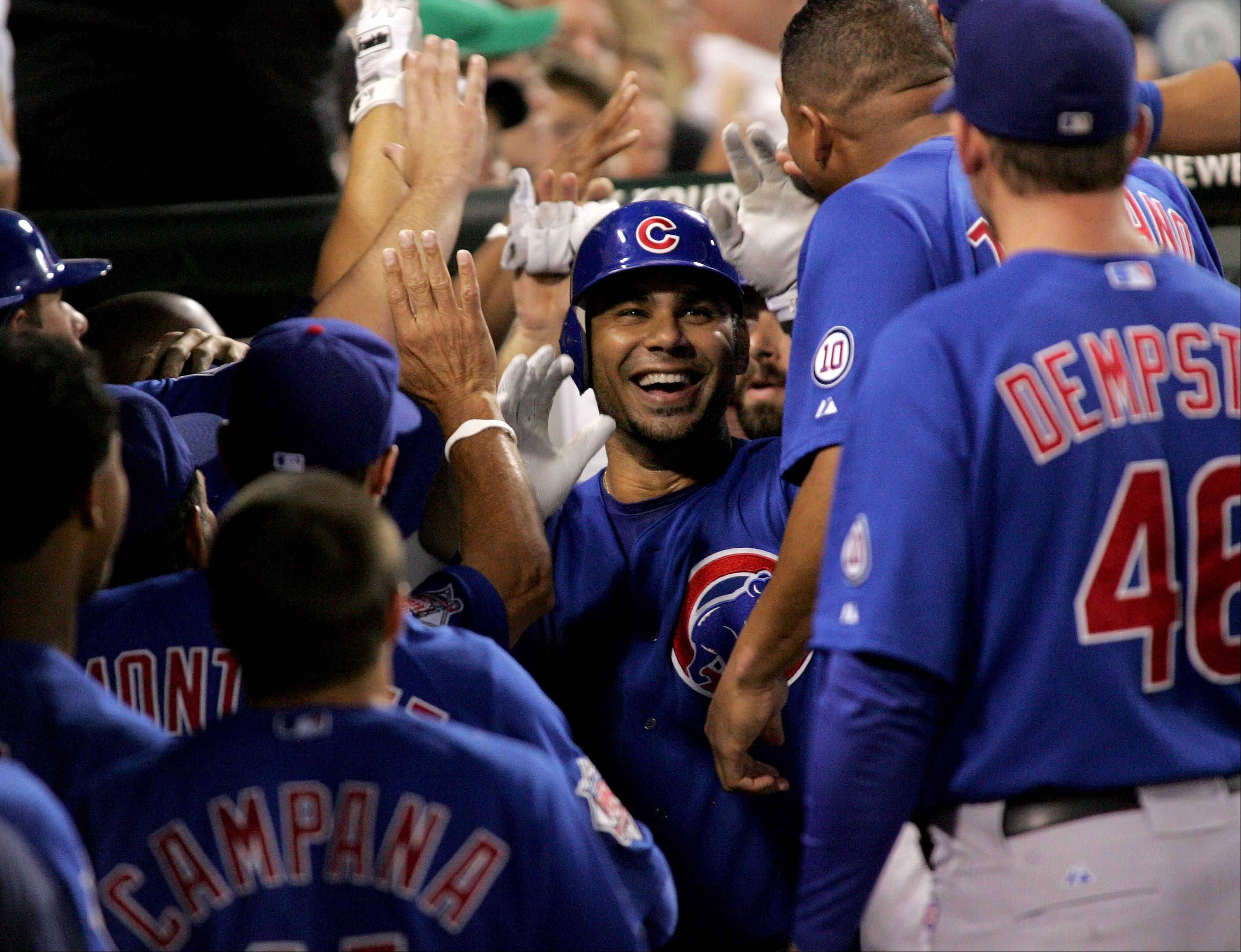 Carlos Pena of the Cubs is greeted in the dugout after hitting a 3-run home run in the 6th inning against the White Sox.