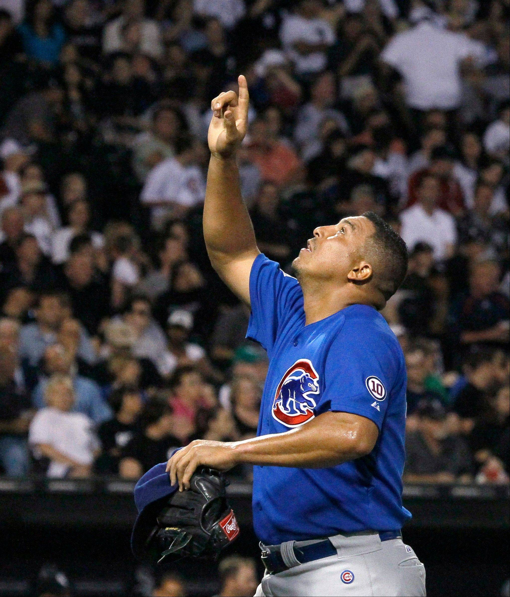 Cubs pitcher Carlos Zambrano points skyward after finishing Monday's seventh inning at U.S. Cellular Field.
