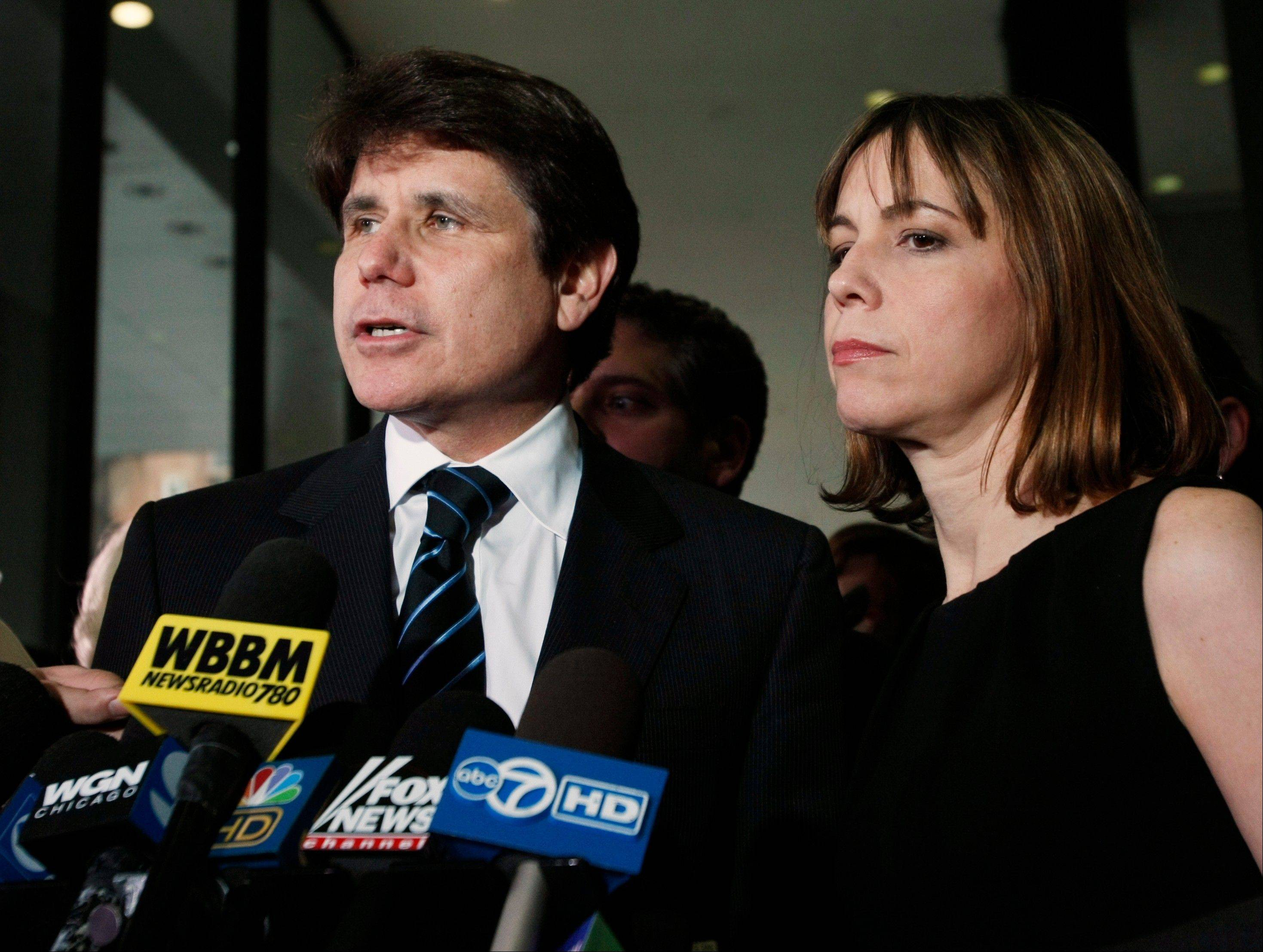 Former Gov. Rod Blagojevich, shown with his wife, has denied all 20 corruption counts he faces at the retrial.