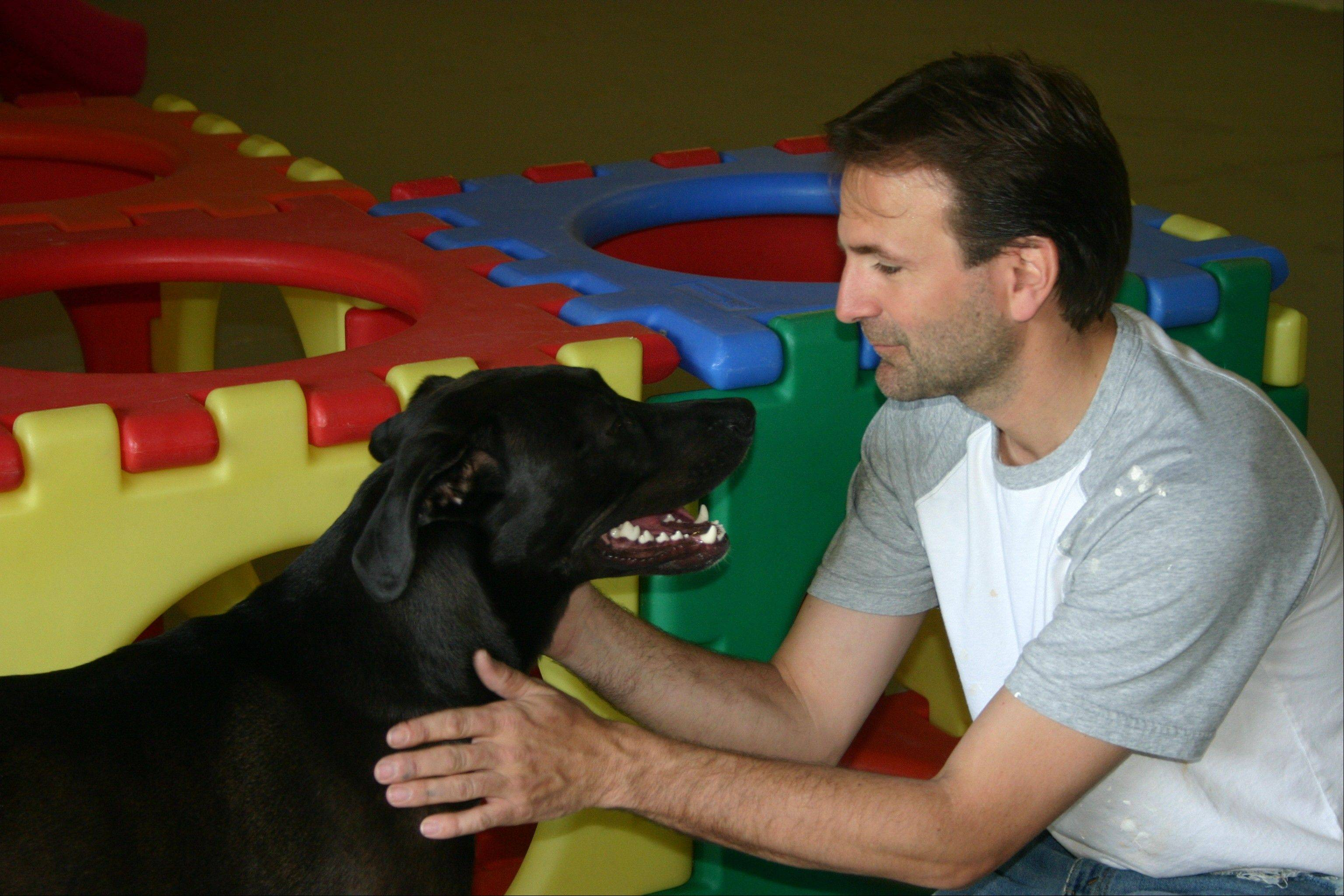 Mike Eckblade of Geneva has opened A New Dog, a dog day care and boarding facility in Geneva. It also features pet grooming by Jennifer Napolitano of Dirty Dog Gone Grooming.