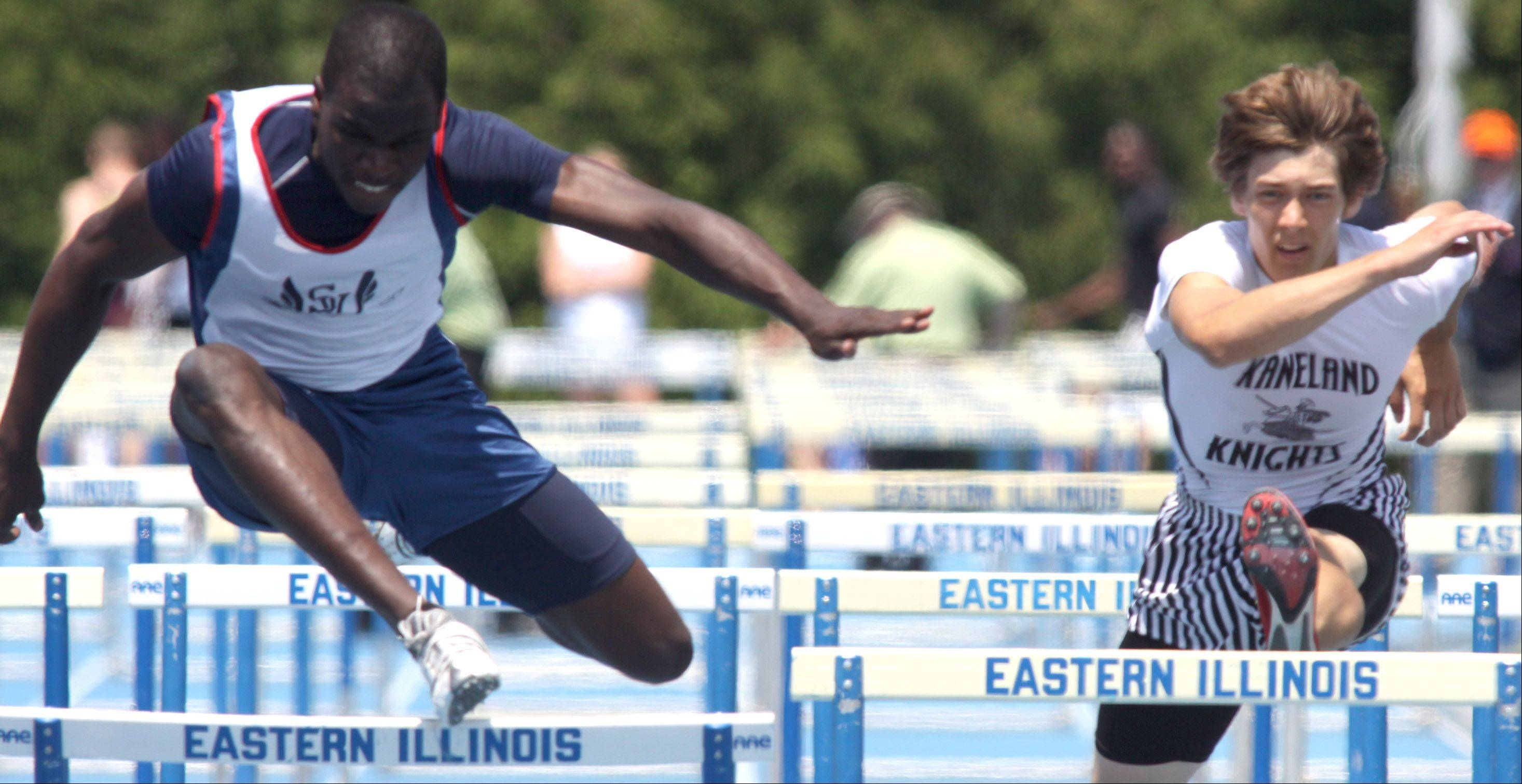 St. Viator's Justin Johnson, left, competes in the Class 2A 110-meter high hurdles during state track finals at O'Brien Field in Charleston in May 2010.