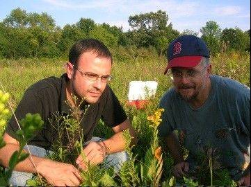 Taking their laboratory work into the field, biologists Doug Taron, wearing his hat, and Vincent Olivares of the Peggy Notebaert Nature Museum are driven to improve the suburban habitats and increase the number of butterflies.