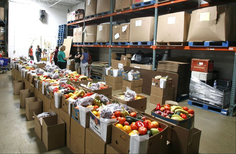 Boxes of food were lined up earlier this month for distribution to DuPage County families in need through the Humanitarian Service Project, based in Carol Stream. The group, founded in 1979, now provides food to 100 families during the summer.