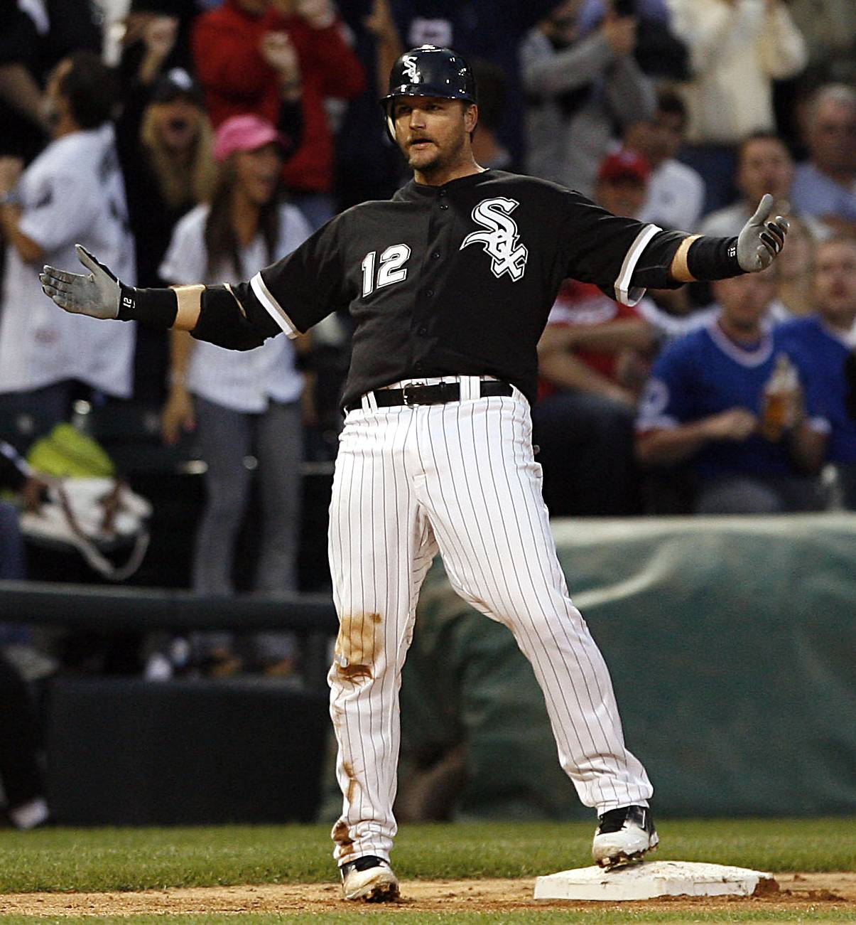 A.J. Pierzynski reacts after hitting a triple in the fourth inning against the Cubs  Wednesday.