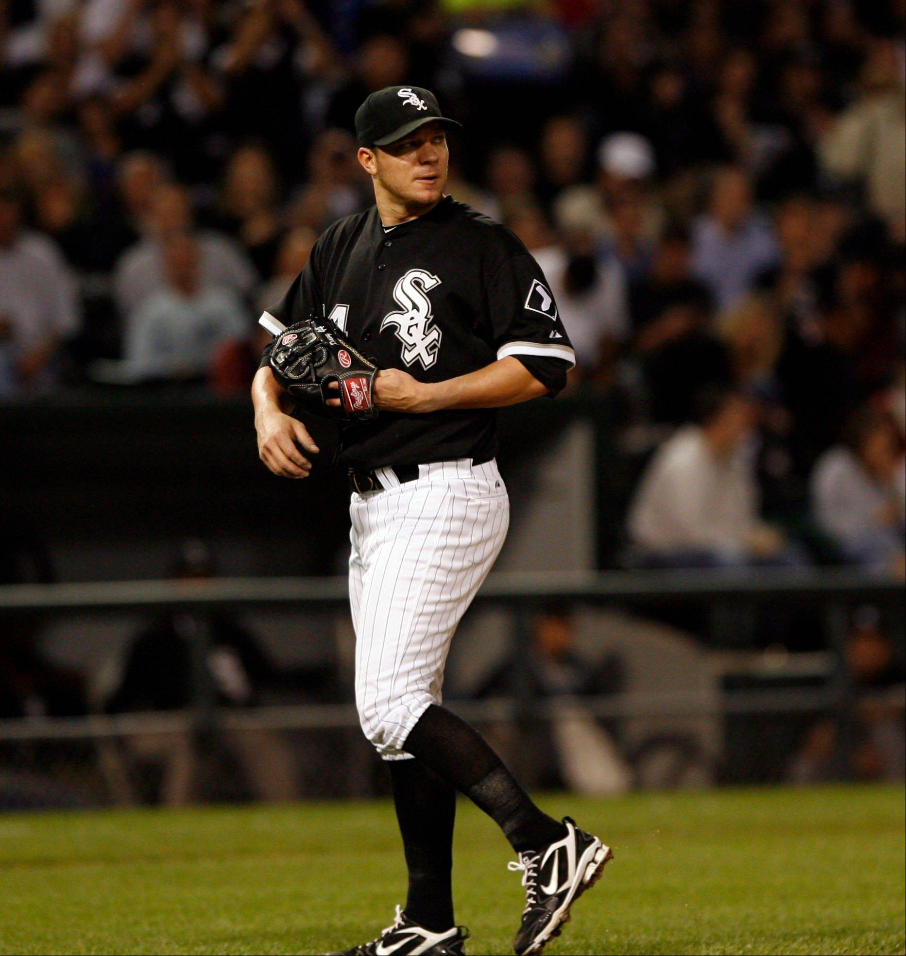 Jake Peavy turns toward the pitcher's mound after being pulled by manager Ozzie Guillen in the sixth inning Wednesday at U.S. Cellular Field.
