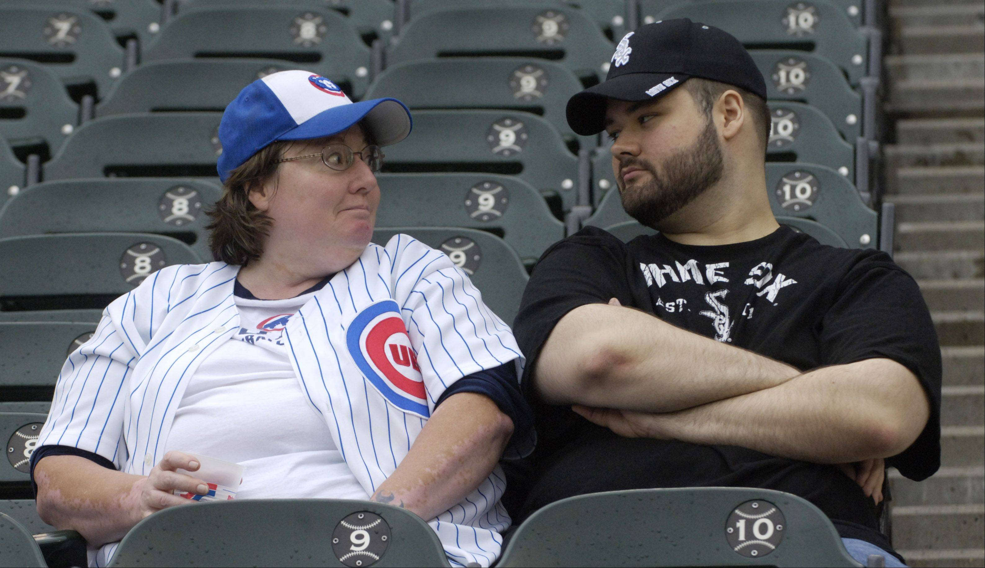 A Cubs and a Sox fan seated together at Wednesday's game at U.S. Cellular Field.