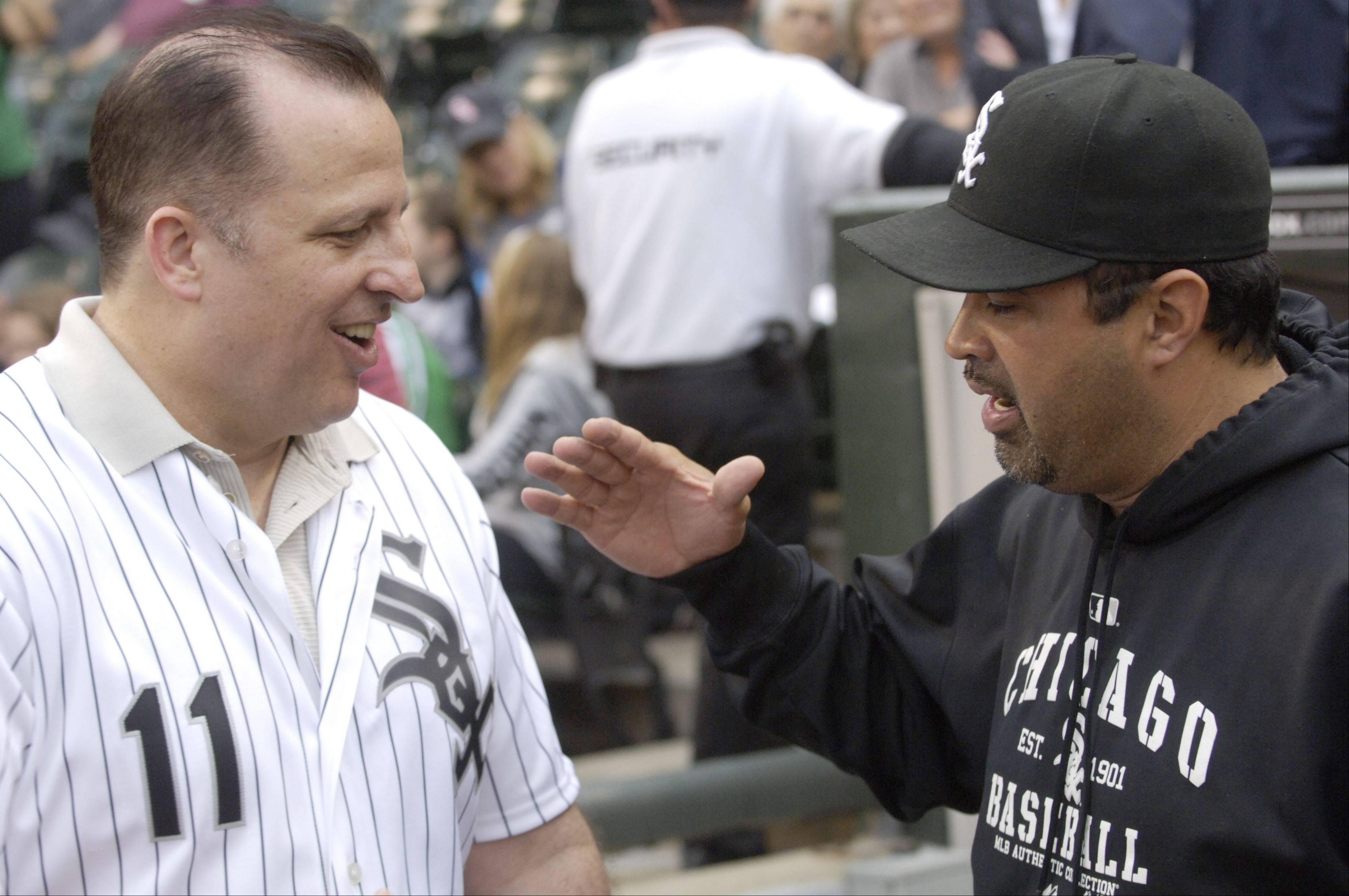 Chicago Bulls coach Tom Thibodeau chats with White Sox Manager Ozzie Guillen prior to Wednesday's game at U.S. Cellular Field.