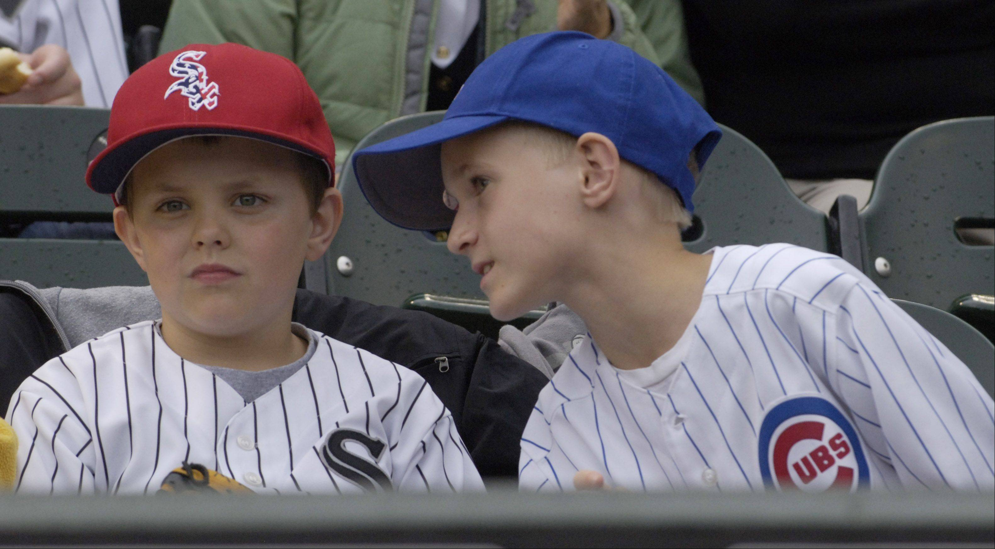 Young Sox and Cubs fans chat while seated together at Wednesday's game at U.S. Cellular Field.