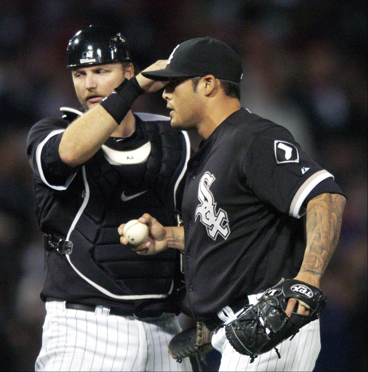 Sox pitcher Sergio Santos gets a pat on the head from catch A.J. Pierzynski after earning a save against the Cubs during Wednesday's game at U.S. Cellular Field.
