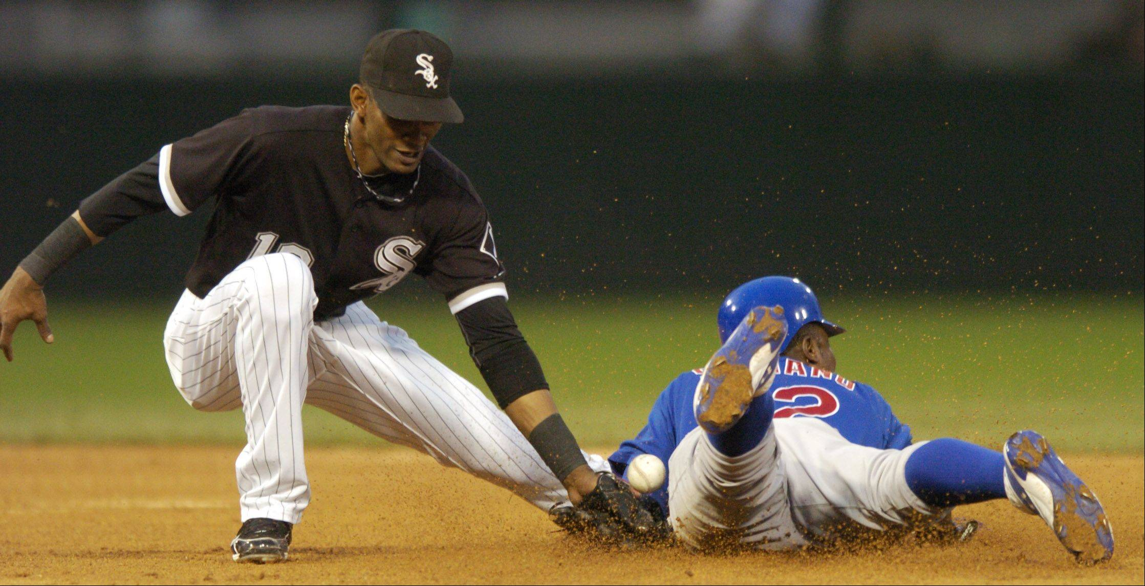 White Sox shortstop Alexei Ramirez can't hang onto the throw as Alfonso Soriano of the Cubs steals second base during Wednesday's game at U.S. Cellular Field.