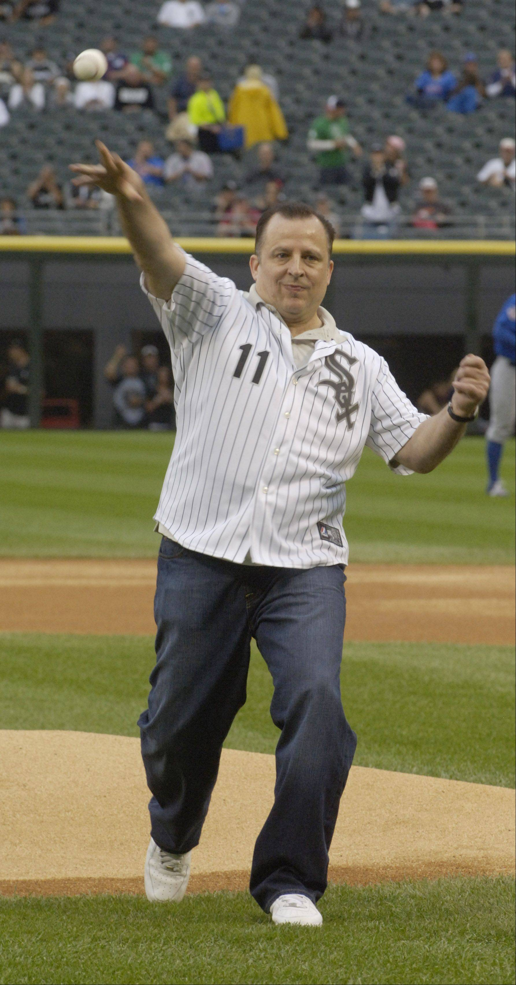 Chicago Bulls coach Tom Thibodeau throws out the ceremonial first pitch prior to Wednesday's game at U.S. Cellular Field.