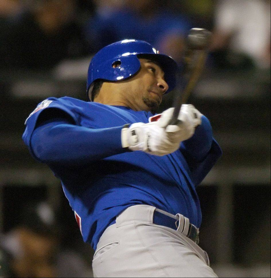 Carlos Pena of the Cubs hits a sixth-inning homerun against the White Sox during Wednesday's game at U.S. Cellular Field.