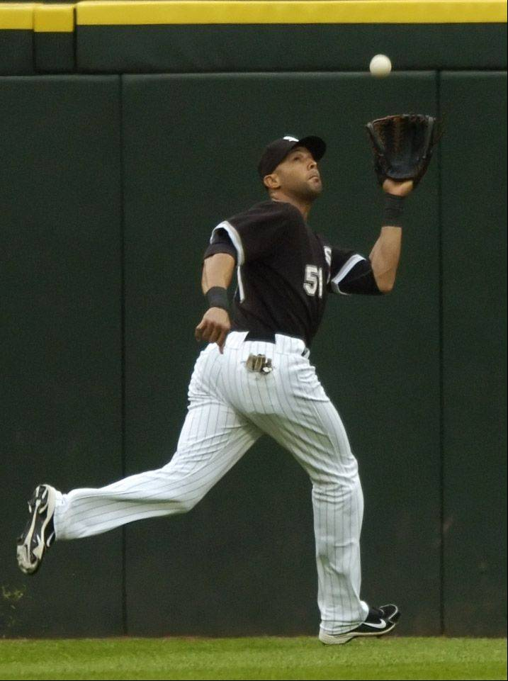 White Sox center fielder Alex Rios chases down a flyball off the bat of the Cubs' Kosuke Fukudome during Wednesday's game at U.S. Cellular Field.