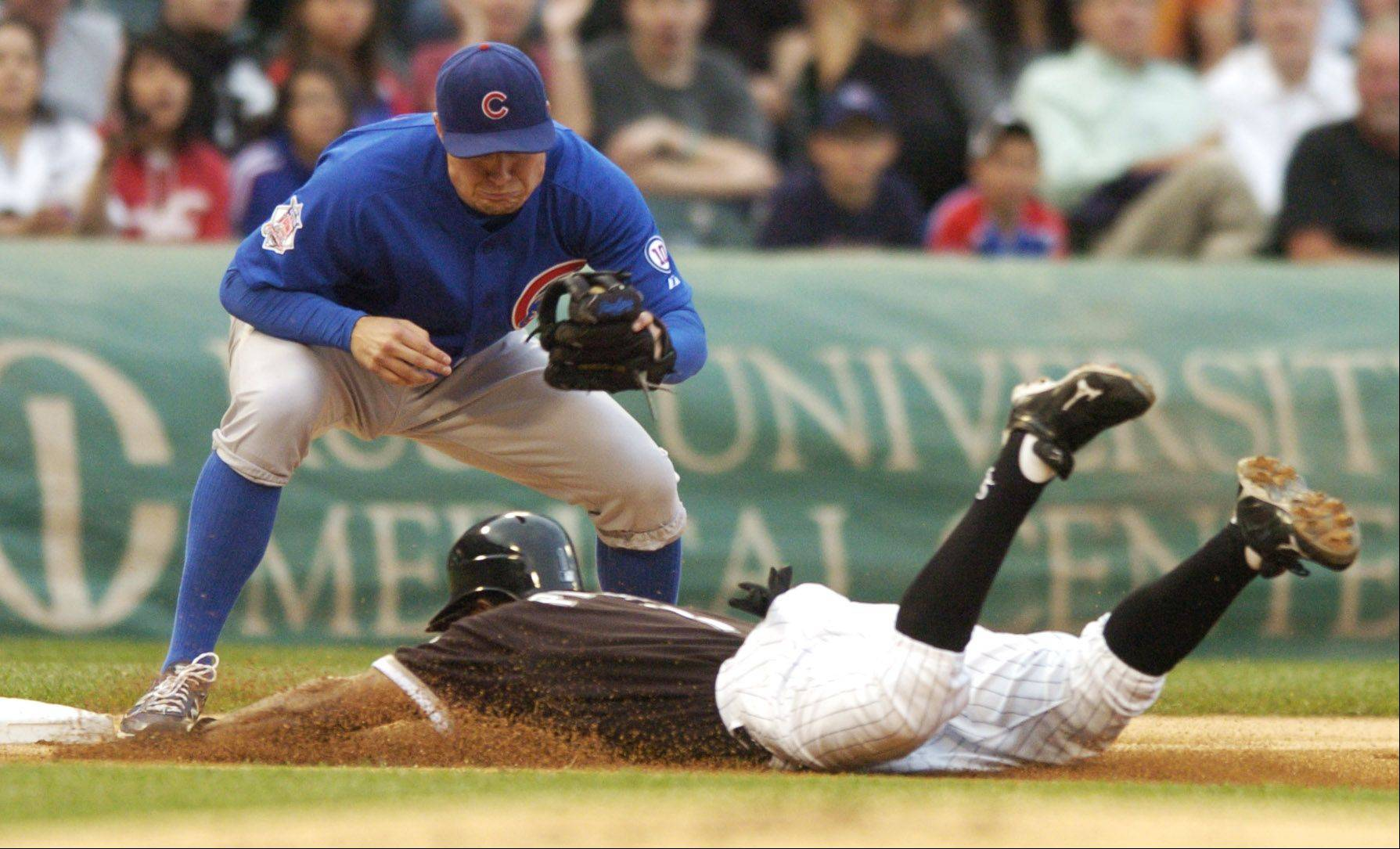 Juan Pierre of the White Sox advances to third on a flyball ahead of the tag by Cubs third baseman Jeff Baker during Wednesday's game at U.S. Cellular Field.