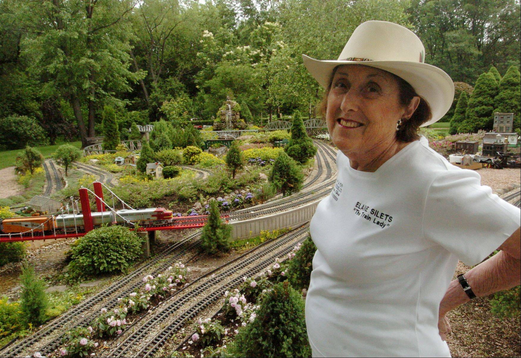 Elaine Silets and her garden railroad at her North Barrington home.
