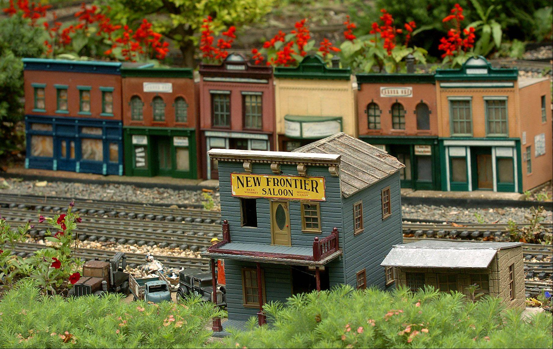 Custom made buildings on Elaine Silets' garden railroad.
