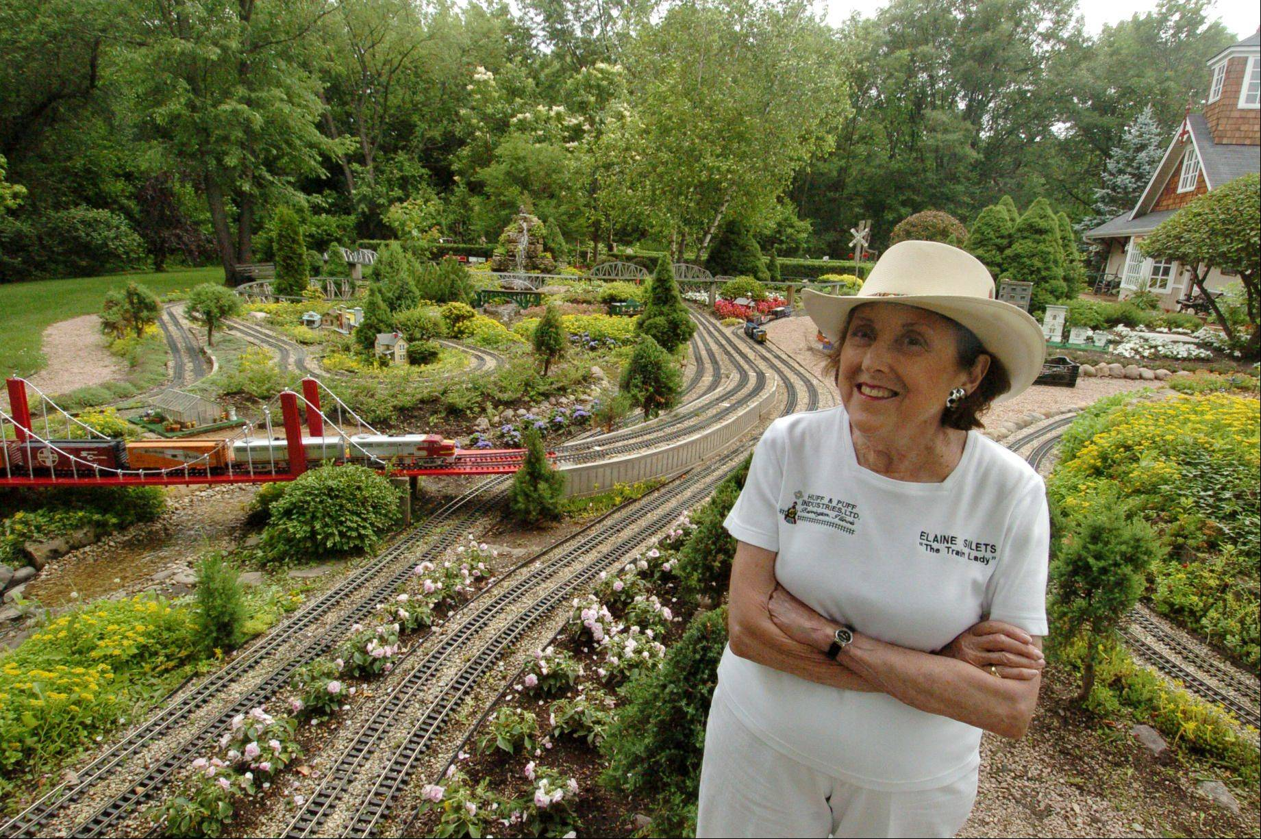 Elaine Silets and her garden railroad.