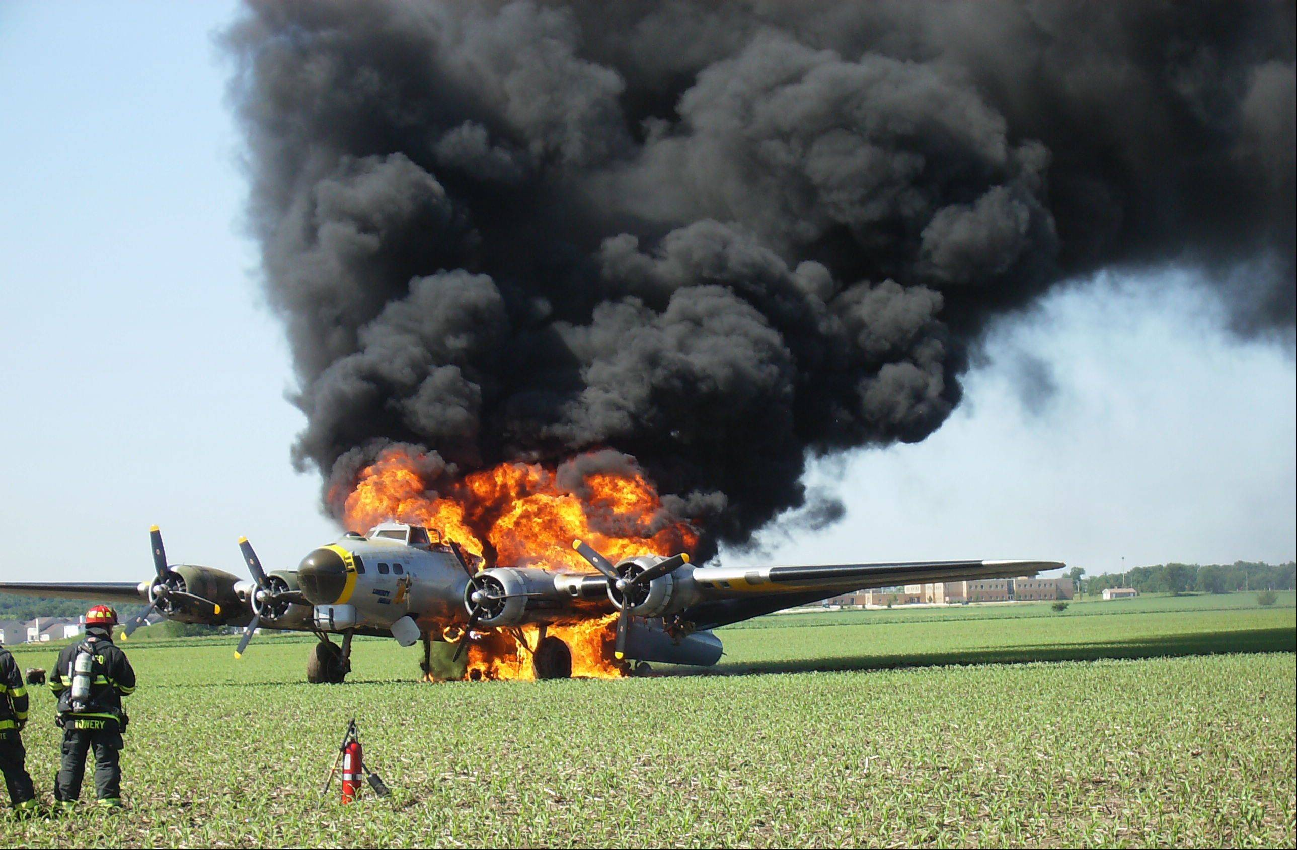 The World War II-era Liberty Belle B-17 burns June 13 after making an emergency landing in Oswego. The National Transportation Safety Board released a preliminary report about the accident Thursday, but the initial findings don't indicate what may have sparked the small fire that apparently began shortly after the plane took off from Aurora Municipal Airport.