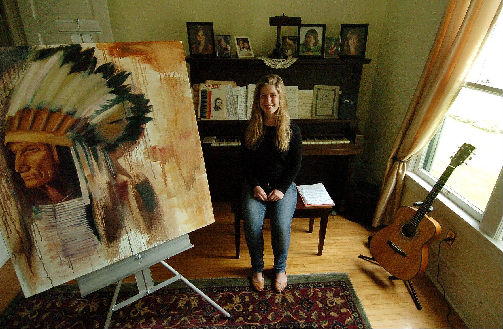 Lucy Miller, a straight-A student from Larkin High School and gifted artist, is seen here with a painting she did for a show for her school district.