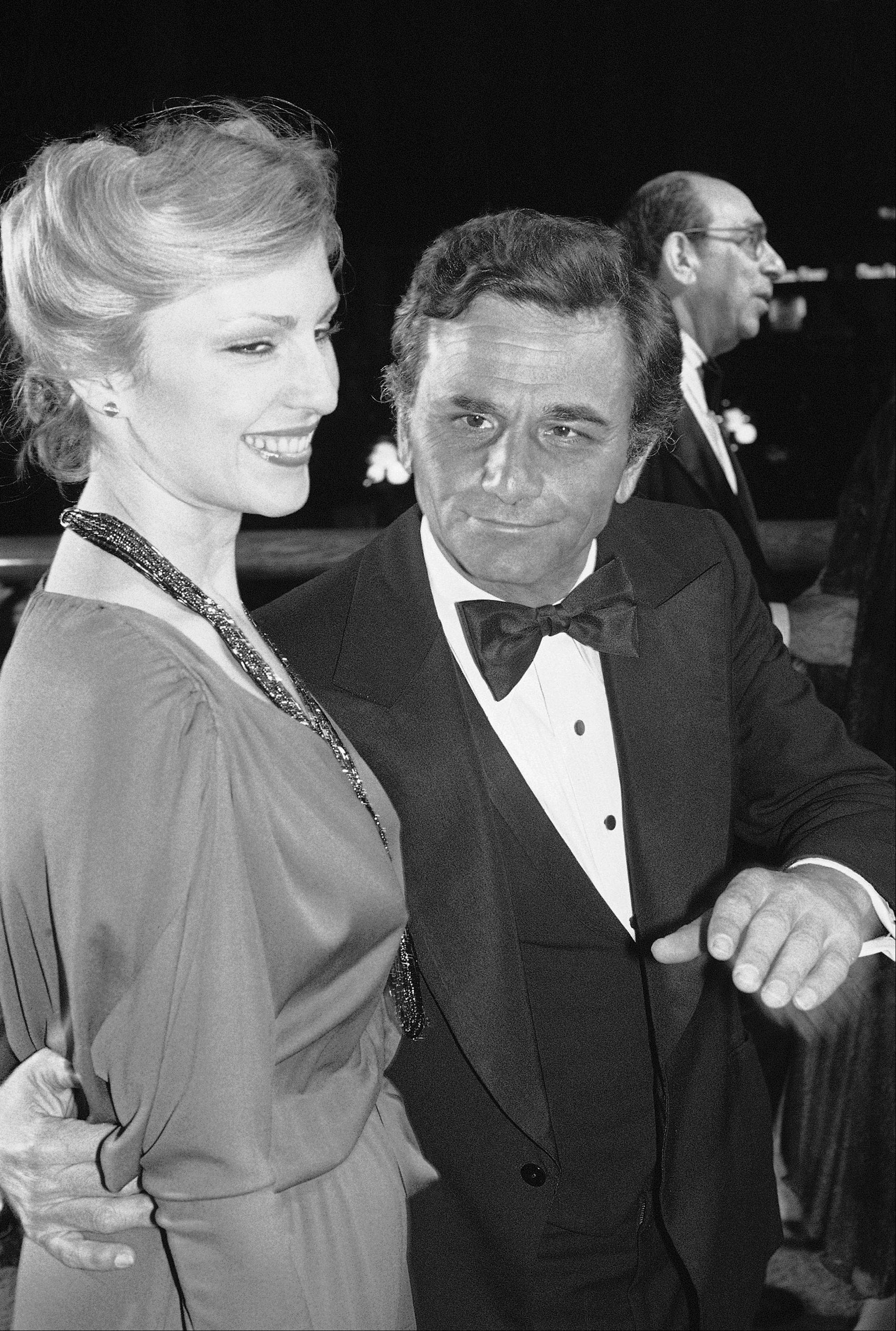 "Actor Peter Falk escorts his wife, Shera, at the premiere of the movie ""California Suite"" in Los Angeles on Tuesday, Dec. 13, 1978. Falk's newest movie ""The Brink's Job"" recently began running in the Westwood section of Los Angeles to meet the Academy Award requirement for consideration for this year's awards."