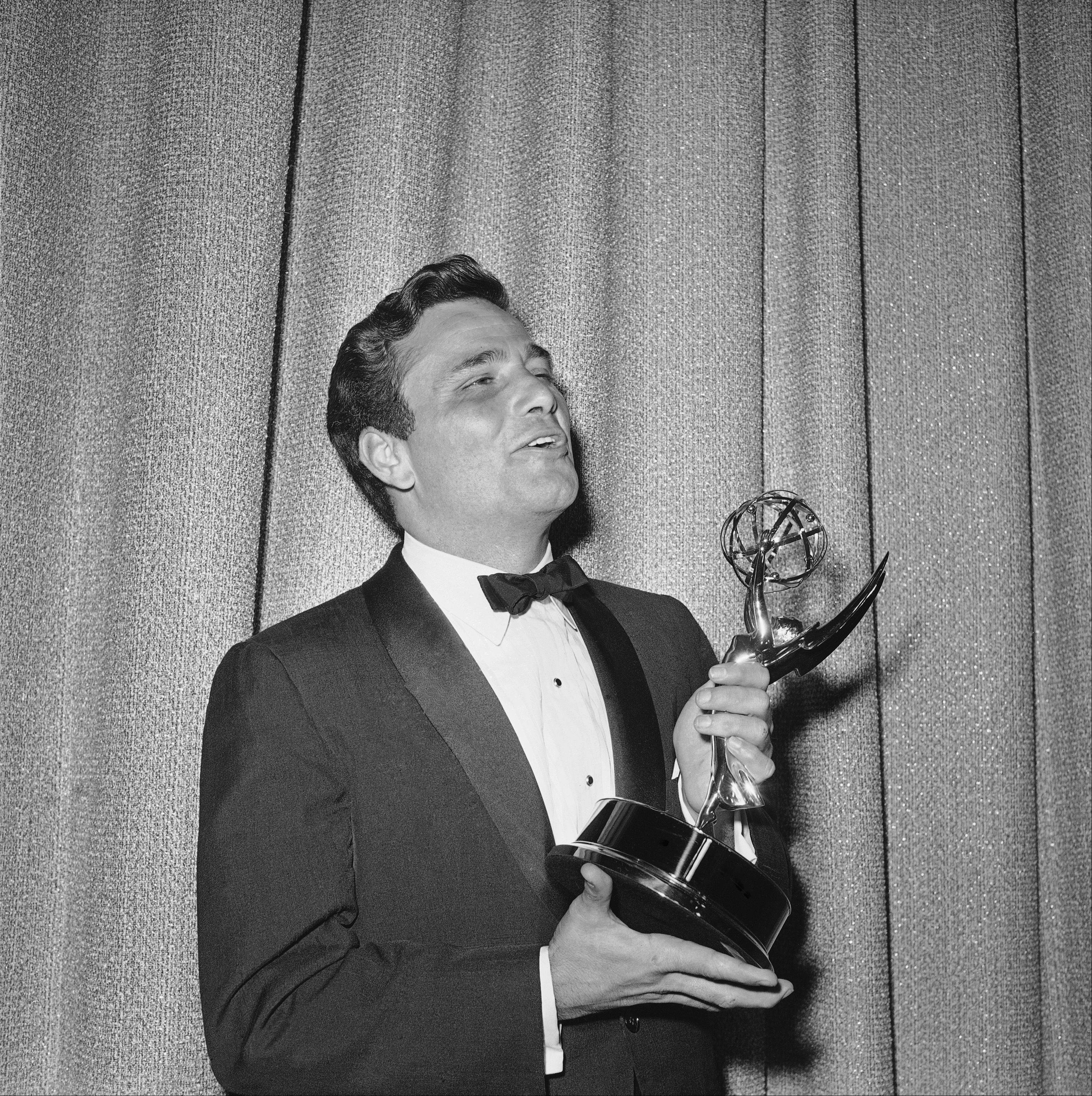 "Peter Falk admires the Television Academy Emmy he won on May 22, 1962 in Hollywood for the outstanding single performance by an actor. He won the award for the hard-bitten truck driver on ""The Price of Tomatoes"", a Dick Powell show."