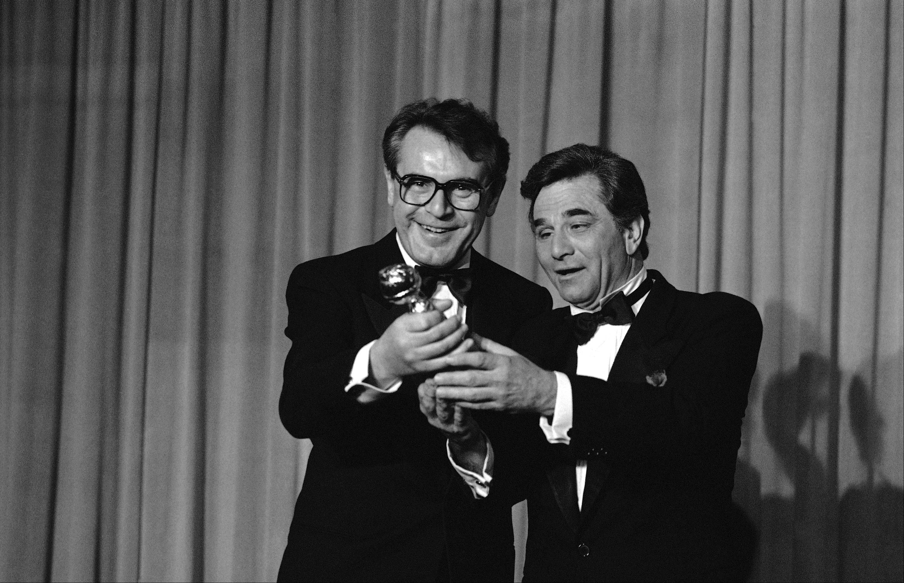 Actor Peter Falk, right, director Milos Forman holds his Golden Globes Award in Beverly Hills, California Saturday, Jan. 27, 1985 for being named Best Director-Motion Picture for his film �Amadeus.� Amadeus won four awards, including Best Film-Drama.