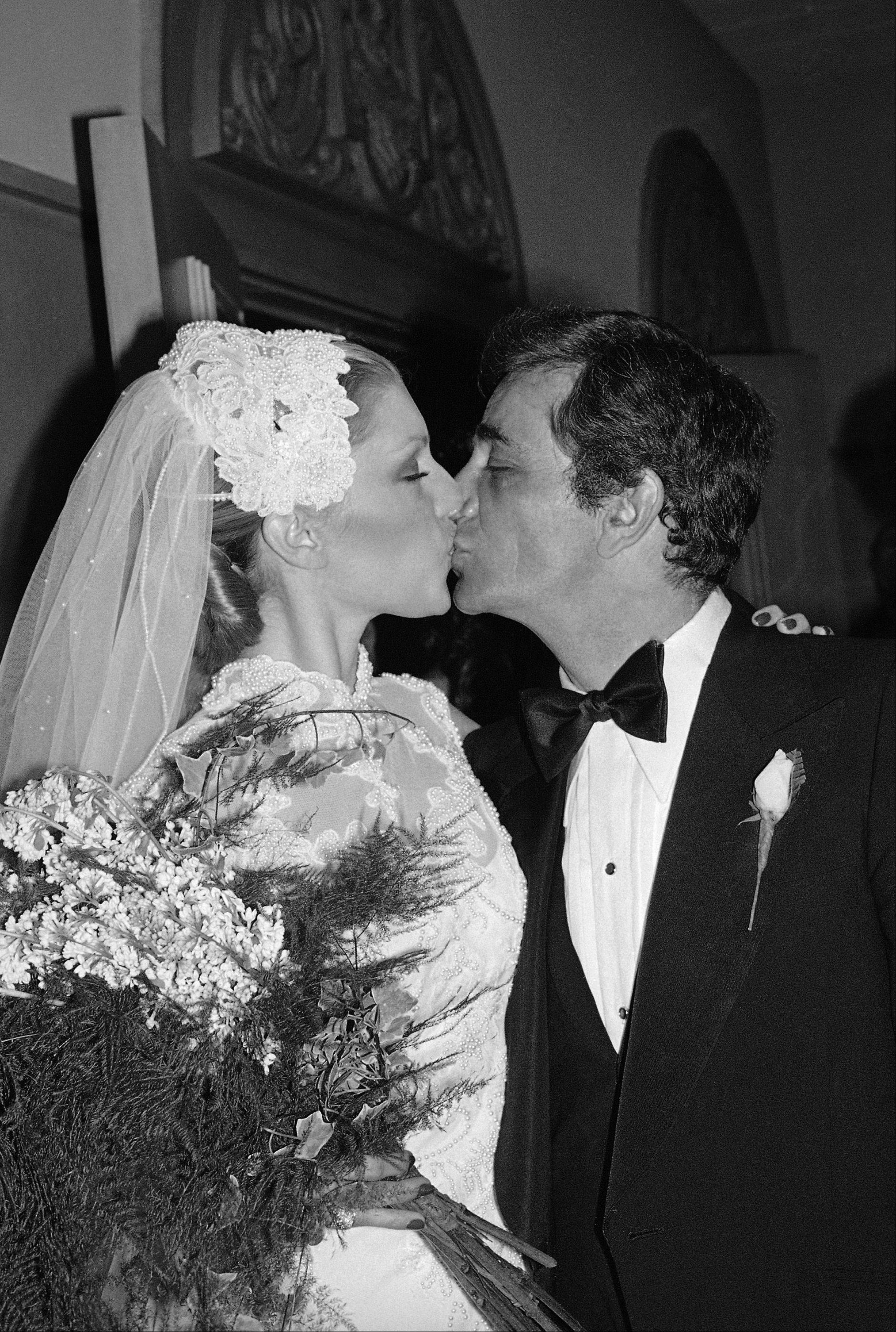 Actor Peter Falk kisses actress Shera Danese as they emerge from the Church of the Good Shephard shortly after their wedding ceremony in Los Angeles on Friday, Dec. 1, 1977. A black tie dinner and dance followed with celebrities such as John Cassavetes, Ben Gazzara, and Bob Dishy attending.