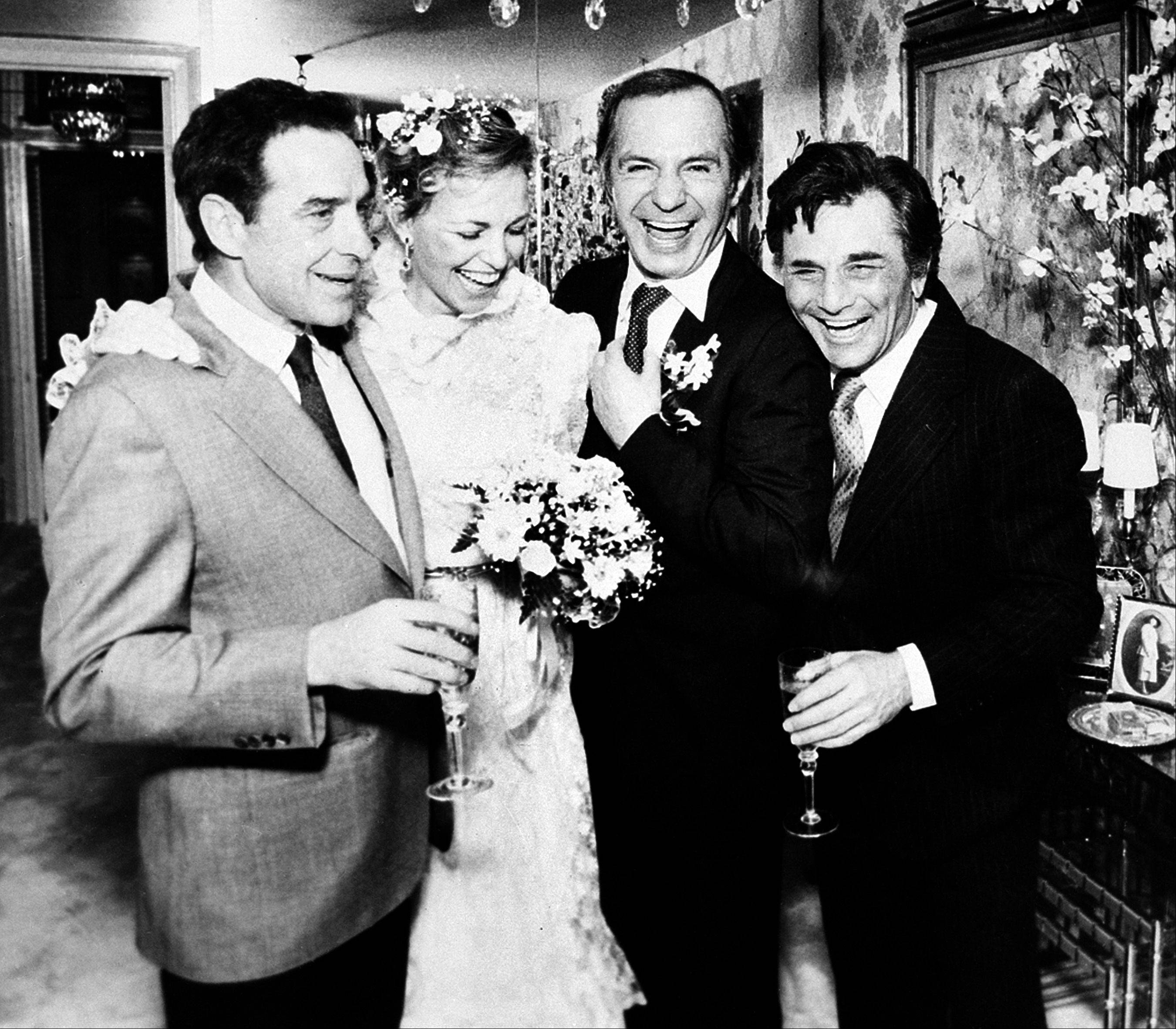 Ben Gazzara and his bride Elke Kriwert are joined by director John Cassavetes, left, and actor Peter Falk, right, after their wedding ceremony in New York, on February 26, 1982..