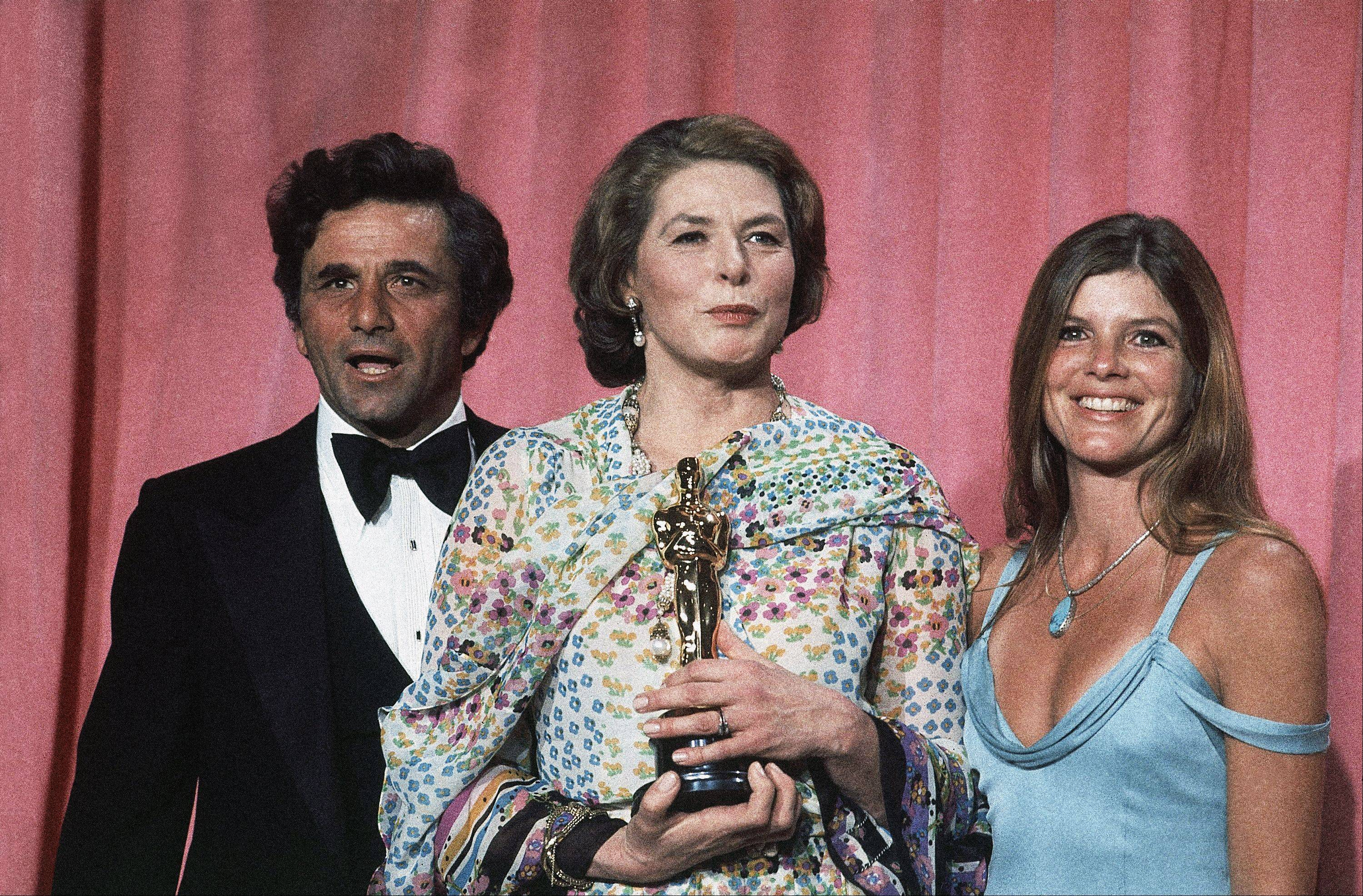 Ingrid Bergman at the 47th Annual Academy Awards ceremony at the Los Angeles Music Center with actor Peter Falk and actress Katherine Ross, who were the presenters April 9, 1975. Berman is holding her Oscar..