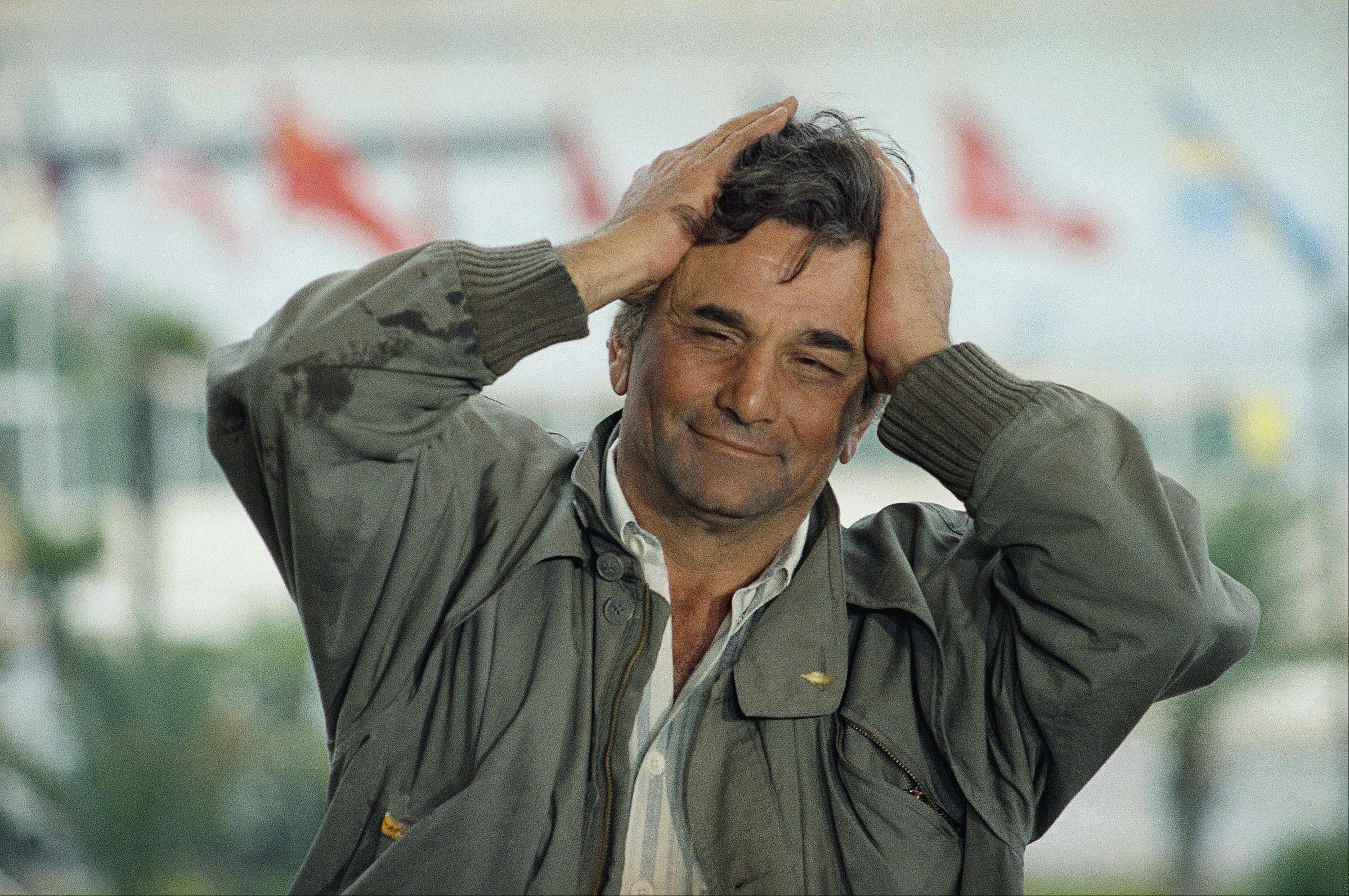 American actor Peter Falk gestures, holding his head in his hands on Sunday, May 17, 1987 in Cannes as he presented the Wim Wenders film in competition for the 40th Cannes Film Festival.