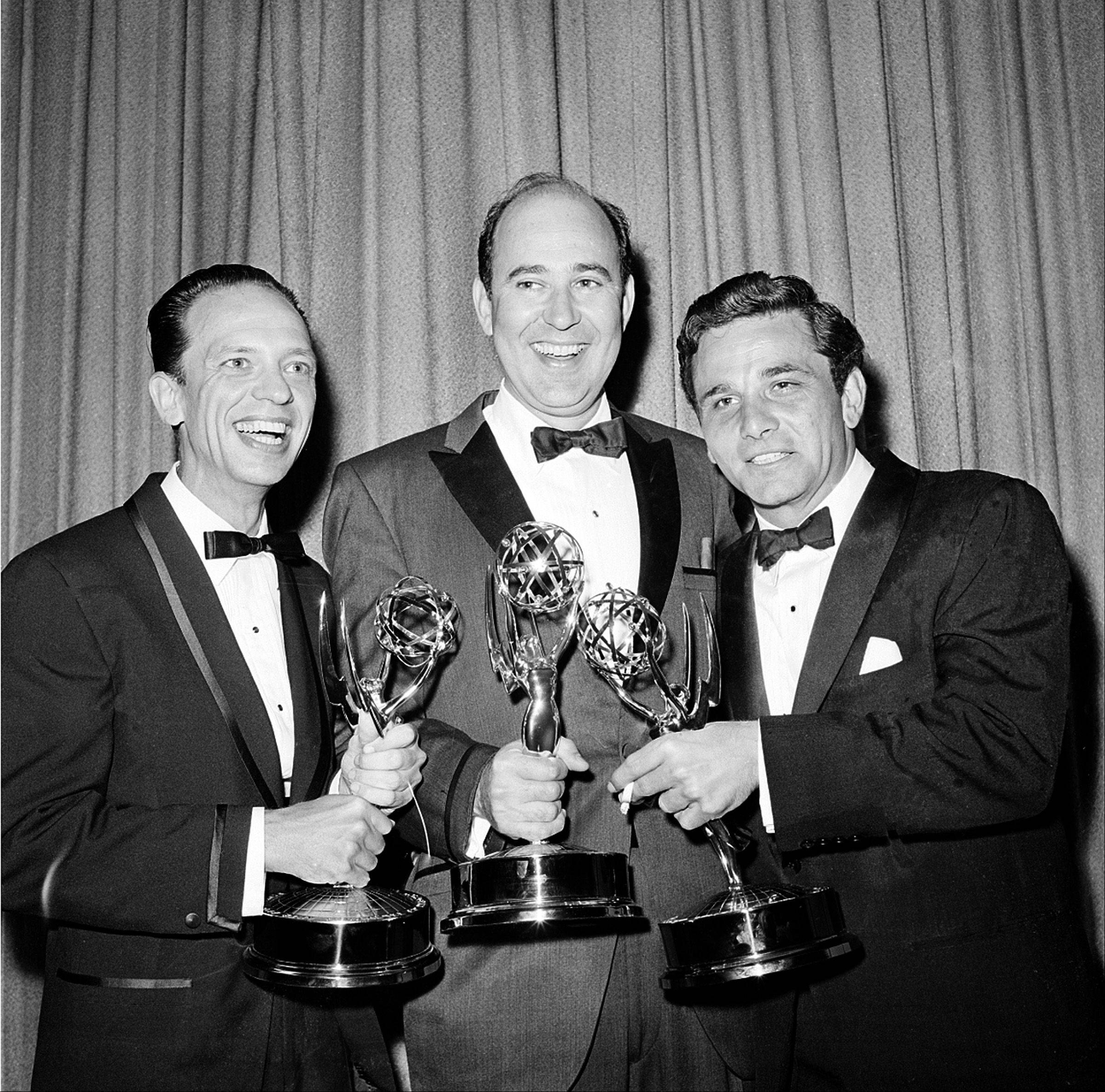 "Writer Carl Reiner, center, poses with actors Don Knotts, left, and Peter Falk as they hold their statuettes at the Emmys Awards in Hollywood, Ca., May 22, 1962. Knotts was named outstanding performance in a supporting role by an actor in ""The Andy Griffith Show""; Reiner won outstanding writing achievement in comedy for the ""Dick Van Dyke Show""; and Falk was named outstanding single performance by an actor in a leading role in ""The Dick Powell Show, The Price of Tomatoes."""