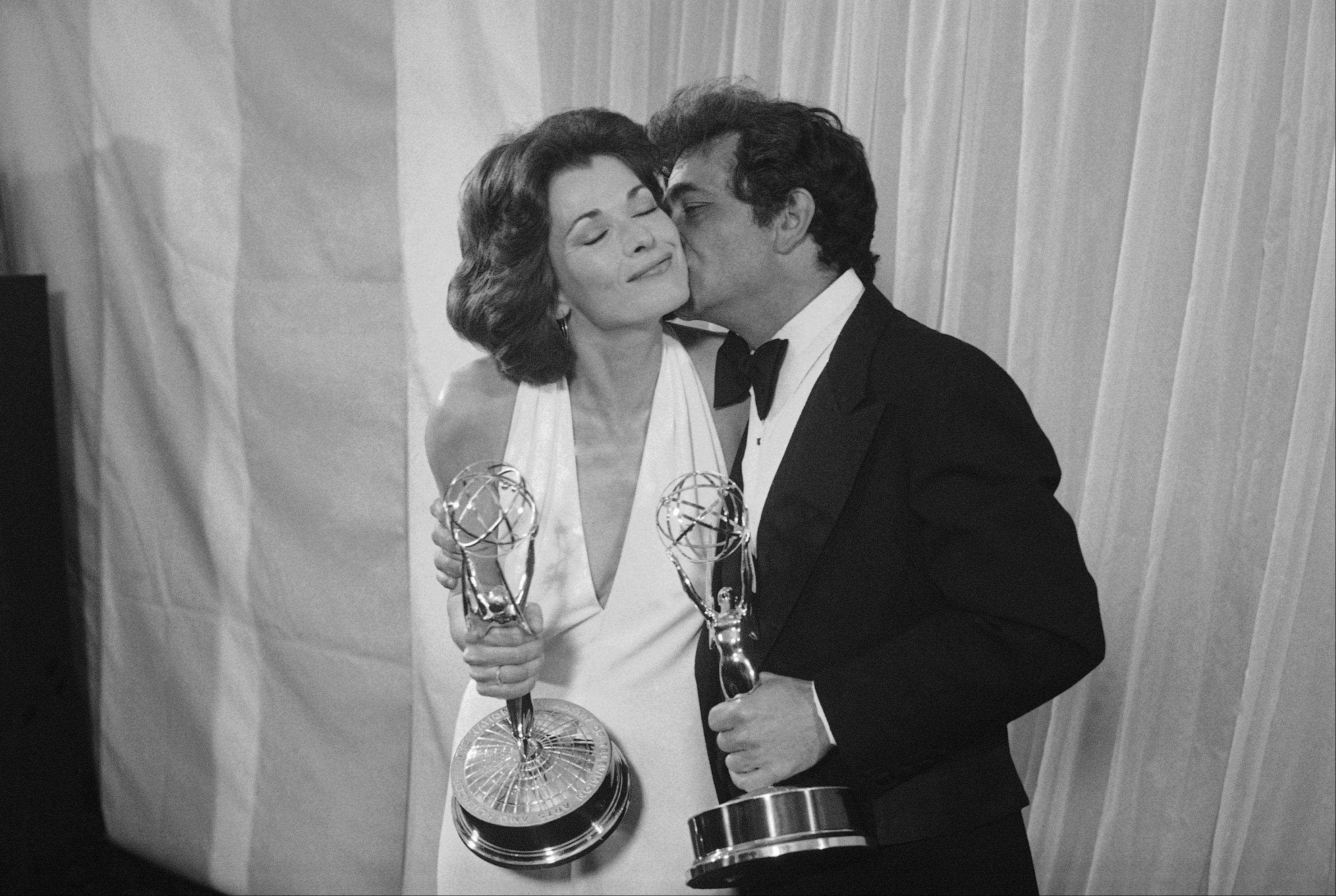 "Peter Falk of ""Columbo"" gives Jessica Walter of ?Amy Prentice? a kiss after both won Emmys on Monday, May 19, 1975. Falk was named best actor in a lined series while Walter won for best actress in a limited series."