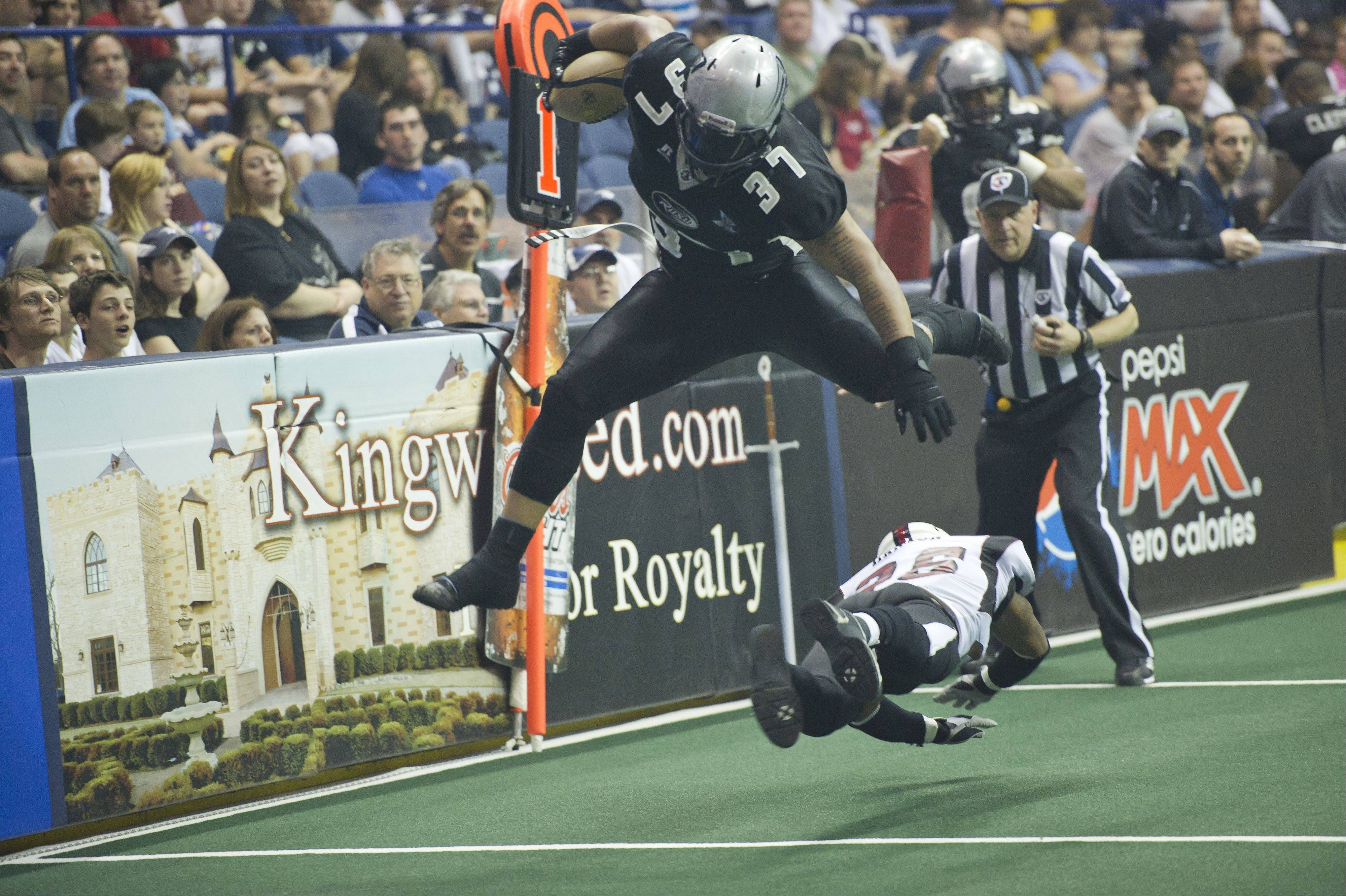 Rush fullback Johnie Kirton leaps over a Dallas Vigilantes player in a game earlier this season. The 9-4 Rush hosts the Iowa Barnstormers on Sunday at the Allstate Arena.