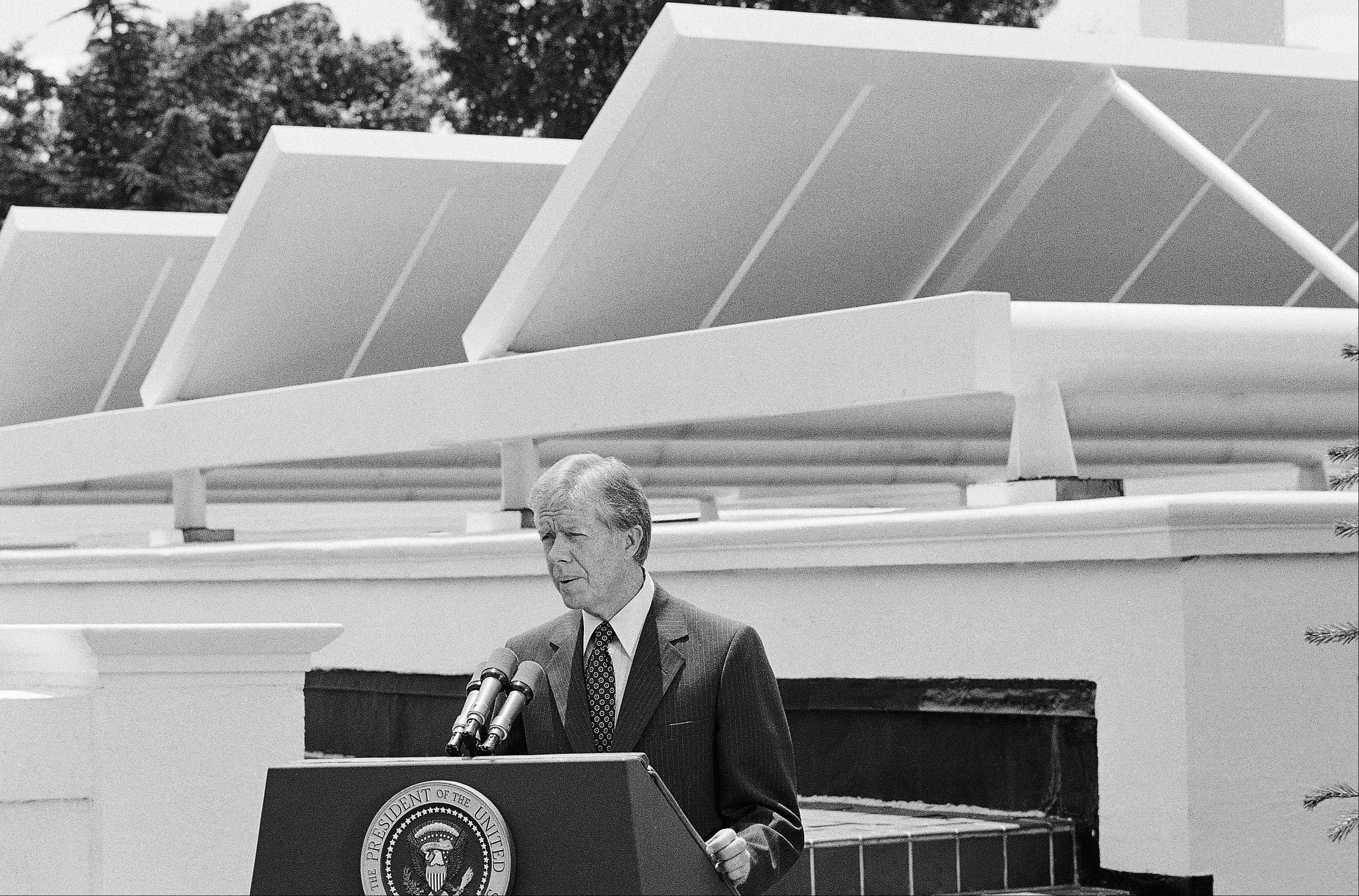 President Jimmy Carter speaks against a backdrop of solar panels at the White House in 1979. Last October, the Obama administration announced plans to install solar panels on the roof on the roof of the White House by the spring of this year, returning the power of the sun to the pinnacle of prominence a quarter-century after Jimmy Carter's pioneering system was taken down. But spring has come and gone, and the promised panels have yet to see the light of day.