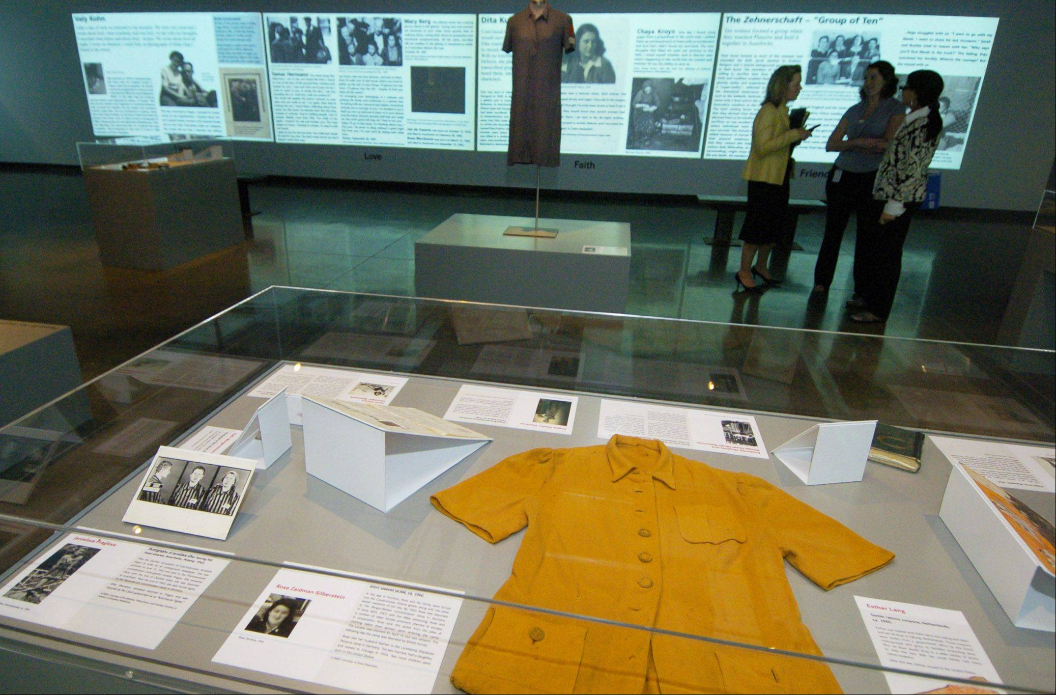"The ""Women in the Holocaust"" exhibit at the Illinois Holocaust Museum in Skokie includes artifacts, as well as stories which are projected on wall-mounted screens."